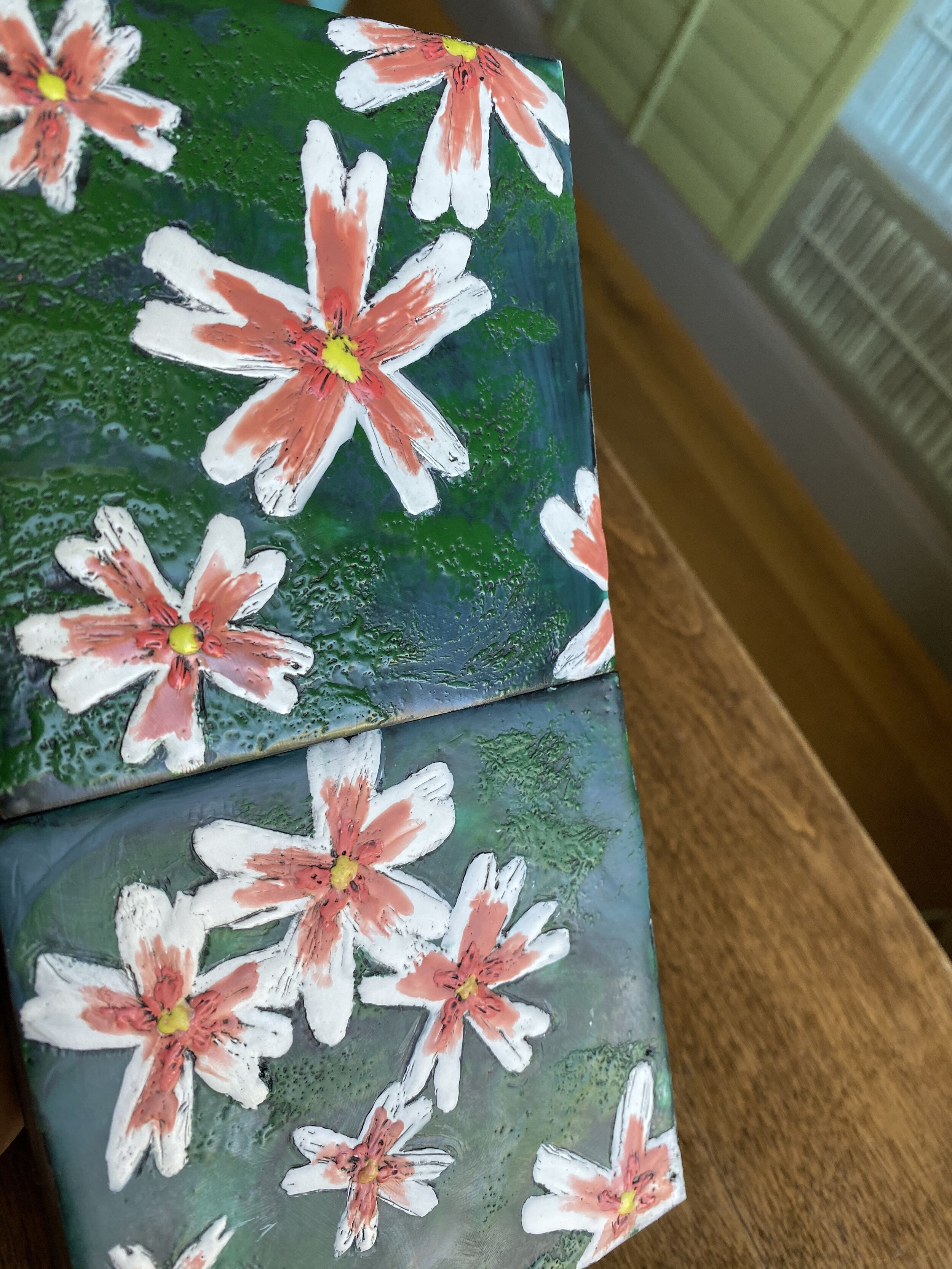 Bloom - The top painting has been buffed with a eye glass cloth. The similar painting on the bottom has not. You can see the difference in shine.