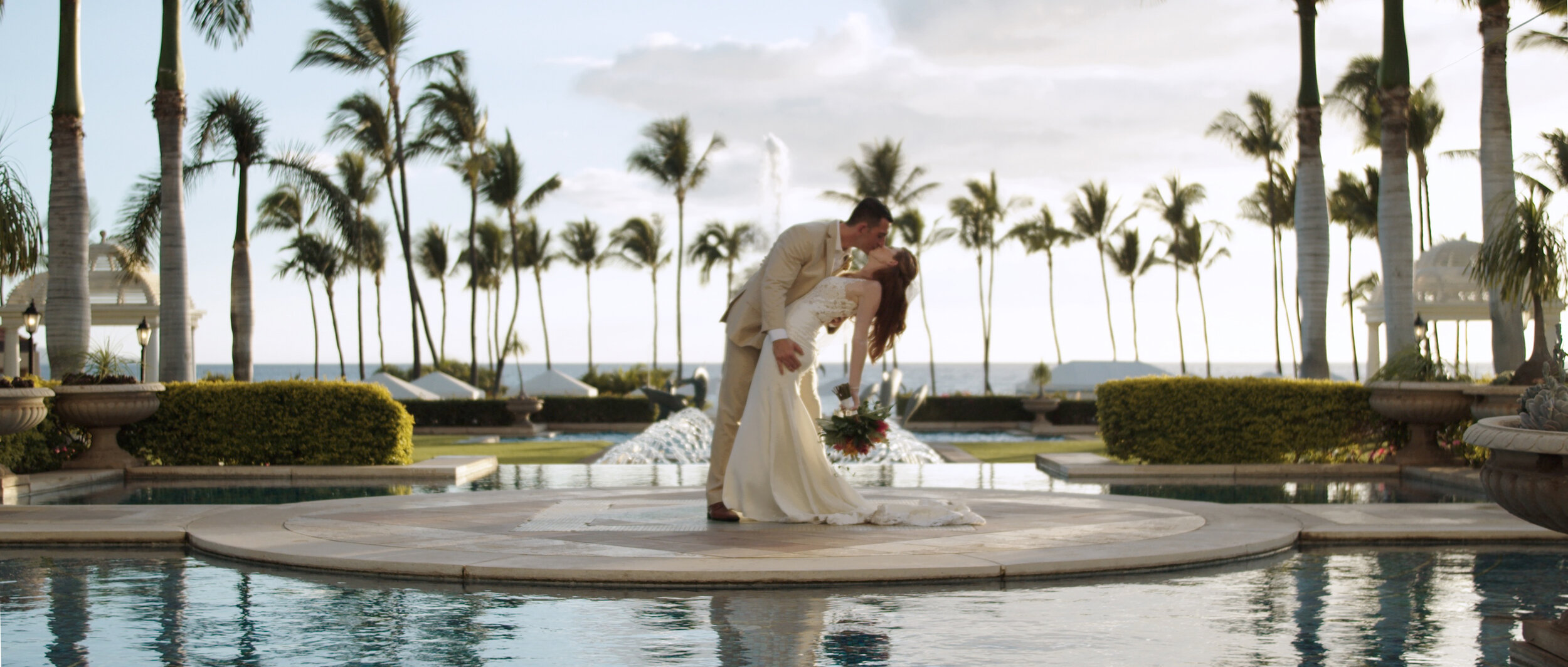 Bride and groom at the Grand Wailea Resort pools
