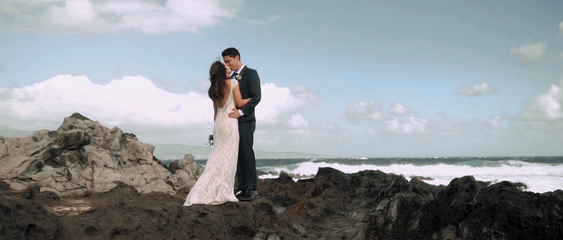 Bride and groom at Ironwoods Beach Cliffs by the ocean
