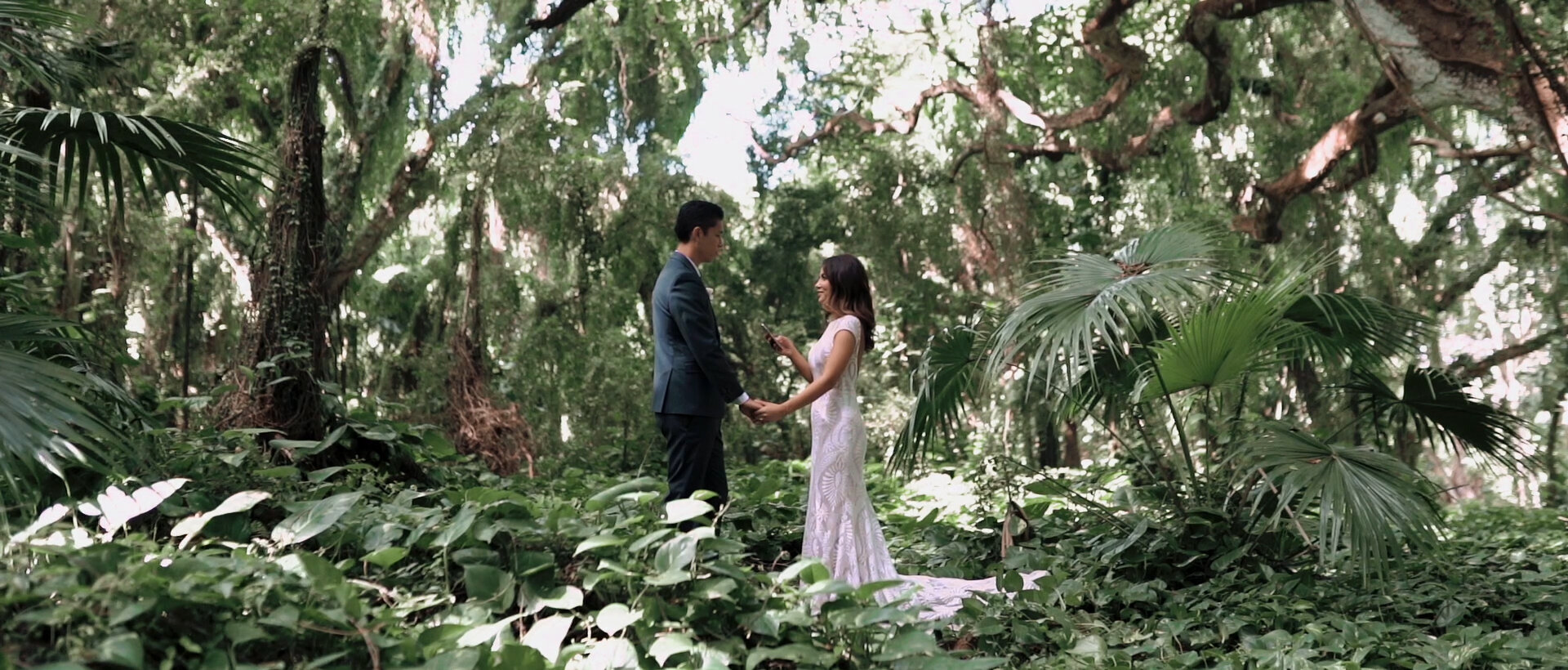Bride and groom reading vows at Honolua Bay Forest