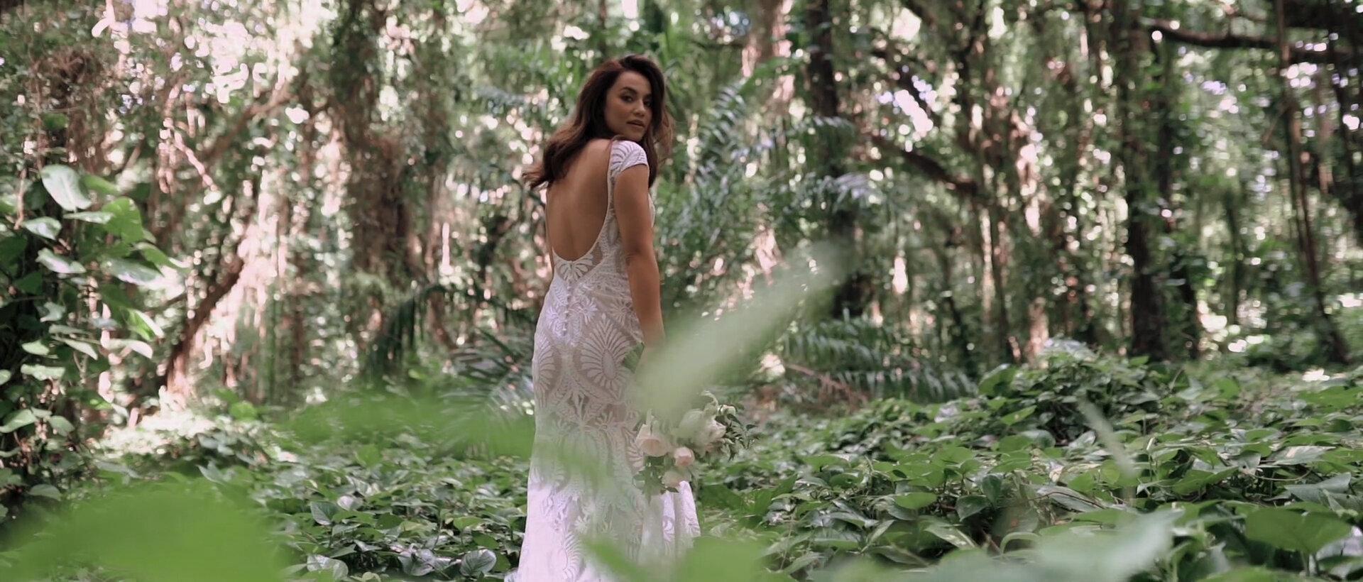 Bride in dress walking at Honolua Bay Forest