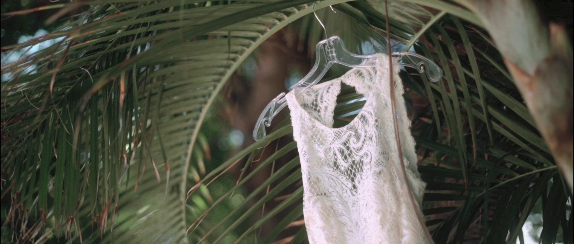 Wedding Dress hanging at Olowalu Plantation House greenery