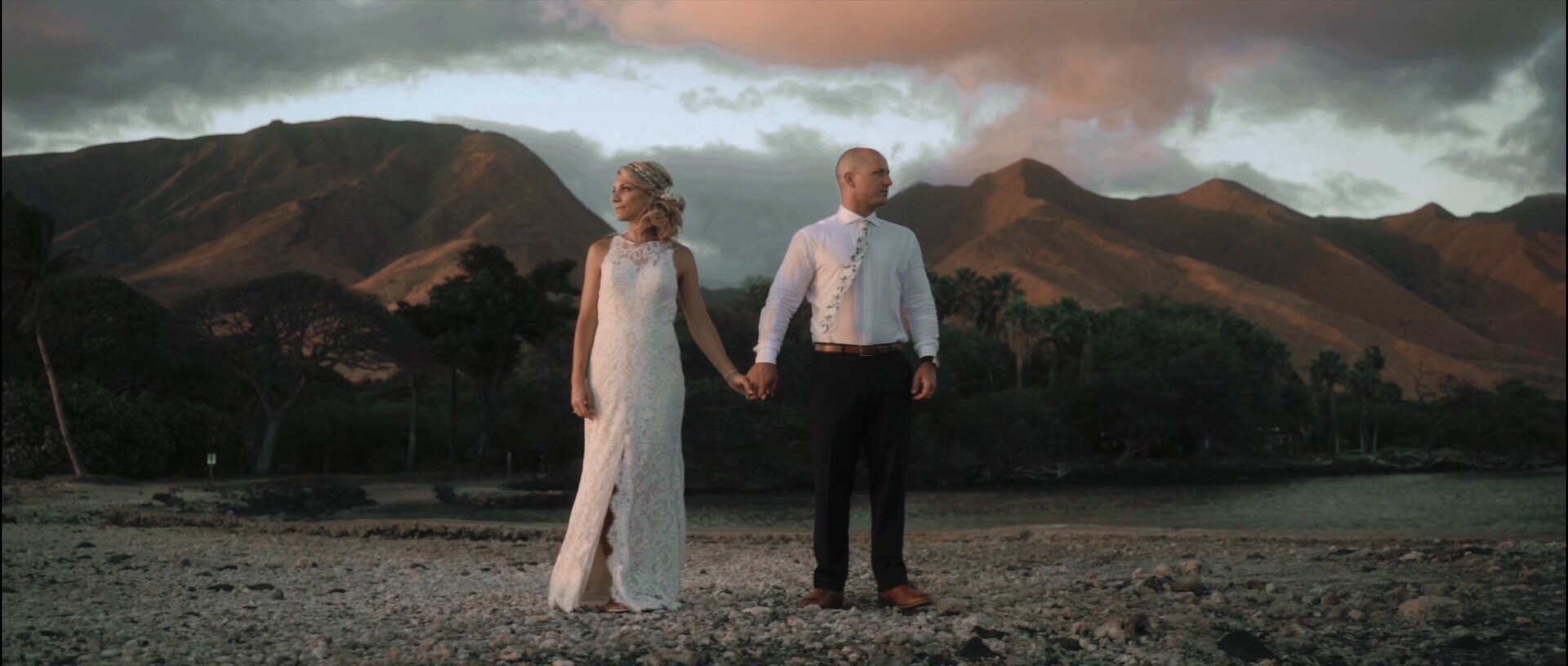 Bride and Groom at the Olowalu Plantation House Pier with mountains backdrop