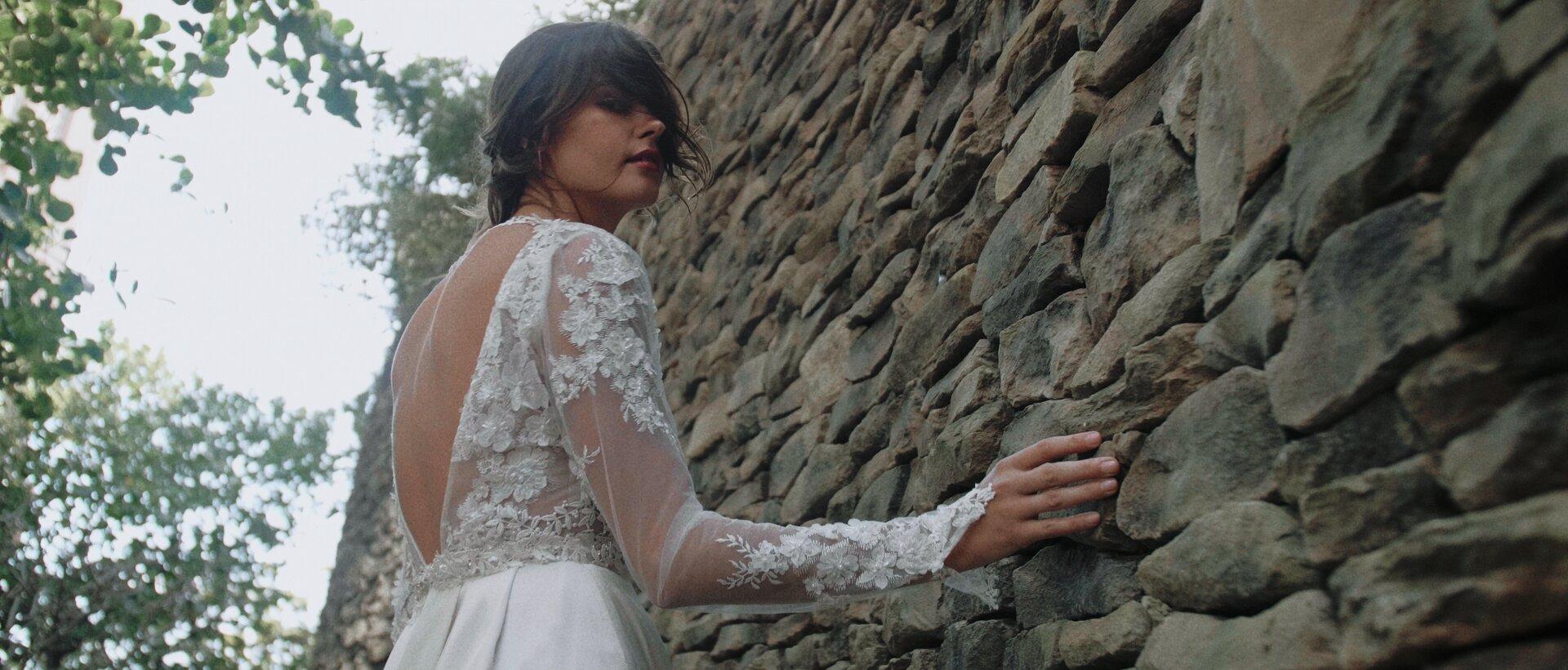 bride walking by Montage Kapalua stone wall luxury wedding