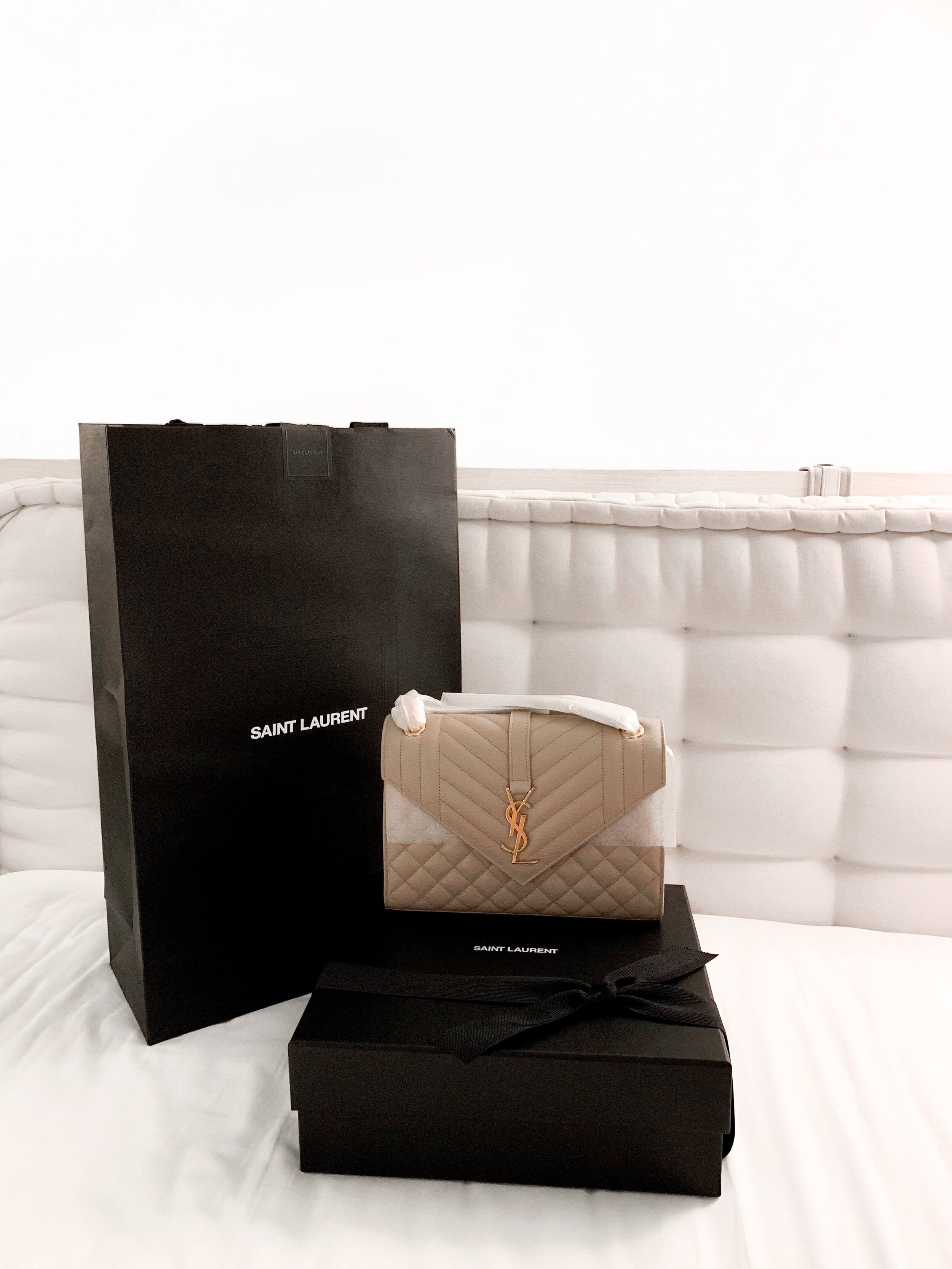Here is a photo of the bag unboxed. You can see that the chains are carefully wrapped in this photo. The exterior size of the bag is quite similar to the Chanel Classic Flap Bag in Medium. The interior of this bag is larger than the Chanel and can fit more items. Similar to the Loulou bag, this bag can be worn three ways: 1) on the shoulder 2) crossbody 3) double-chained on the shoulder. As of the moment, I look for this versatility in a bag. There is also a flap in the back, like the Chanel bag.