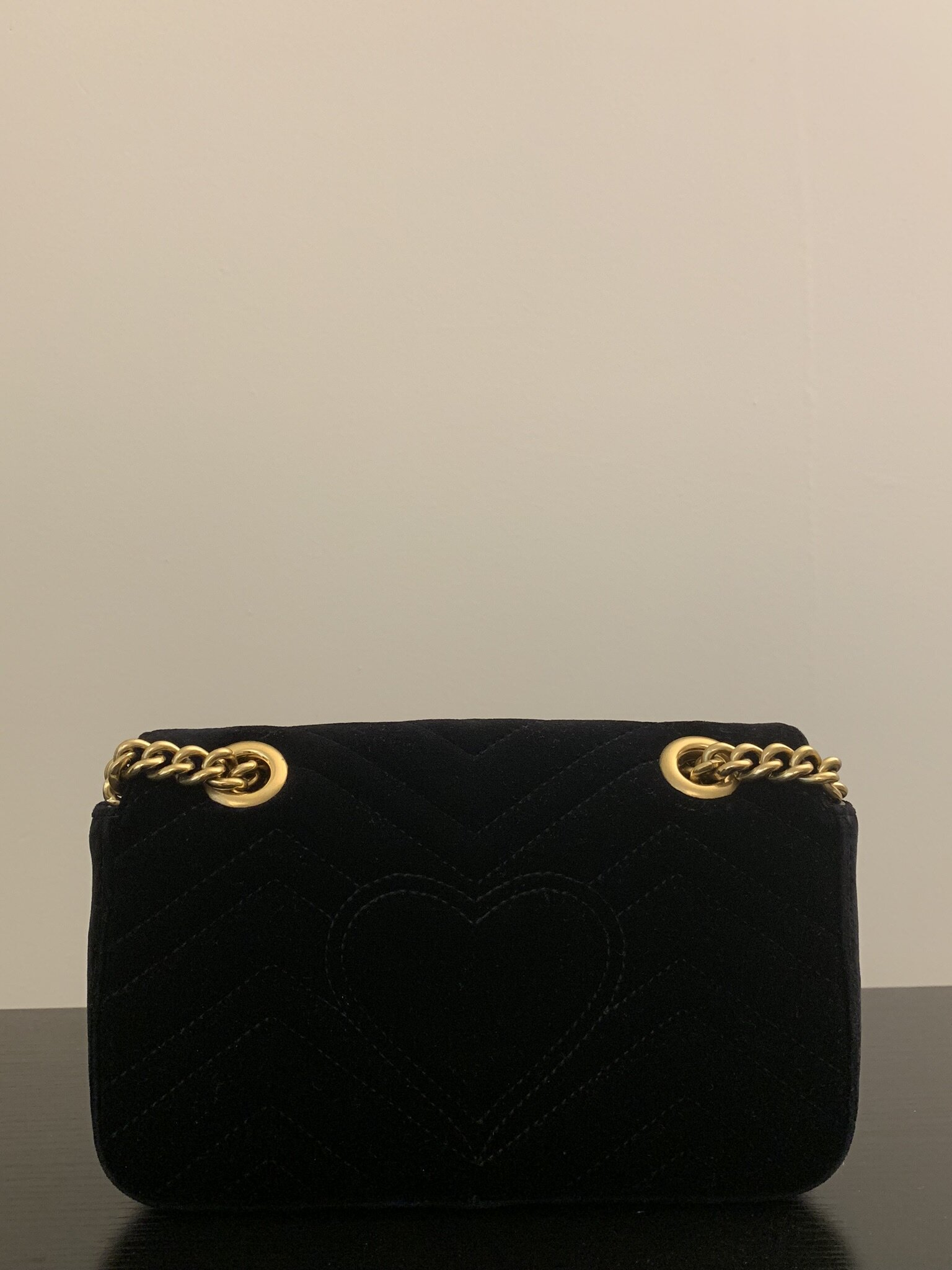 On the back of the purse, there is an adorable heart shape.