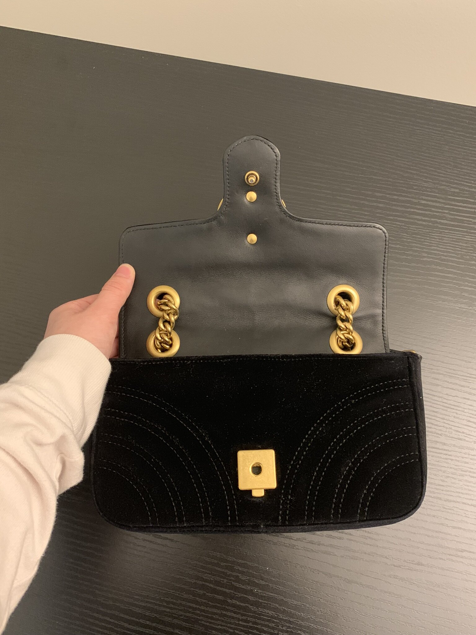 On the inside of the flap, there is denting in the leather due to the opening and closing of the purse. The wear and tear is normal and this is not too bad. This is the condition being that I am gentle with my items.