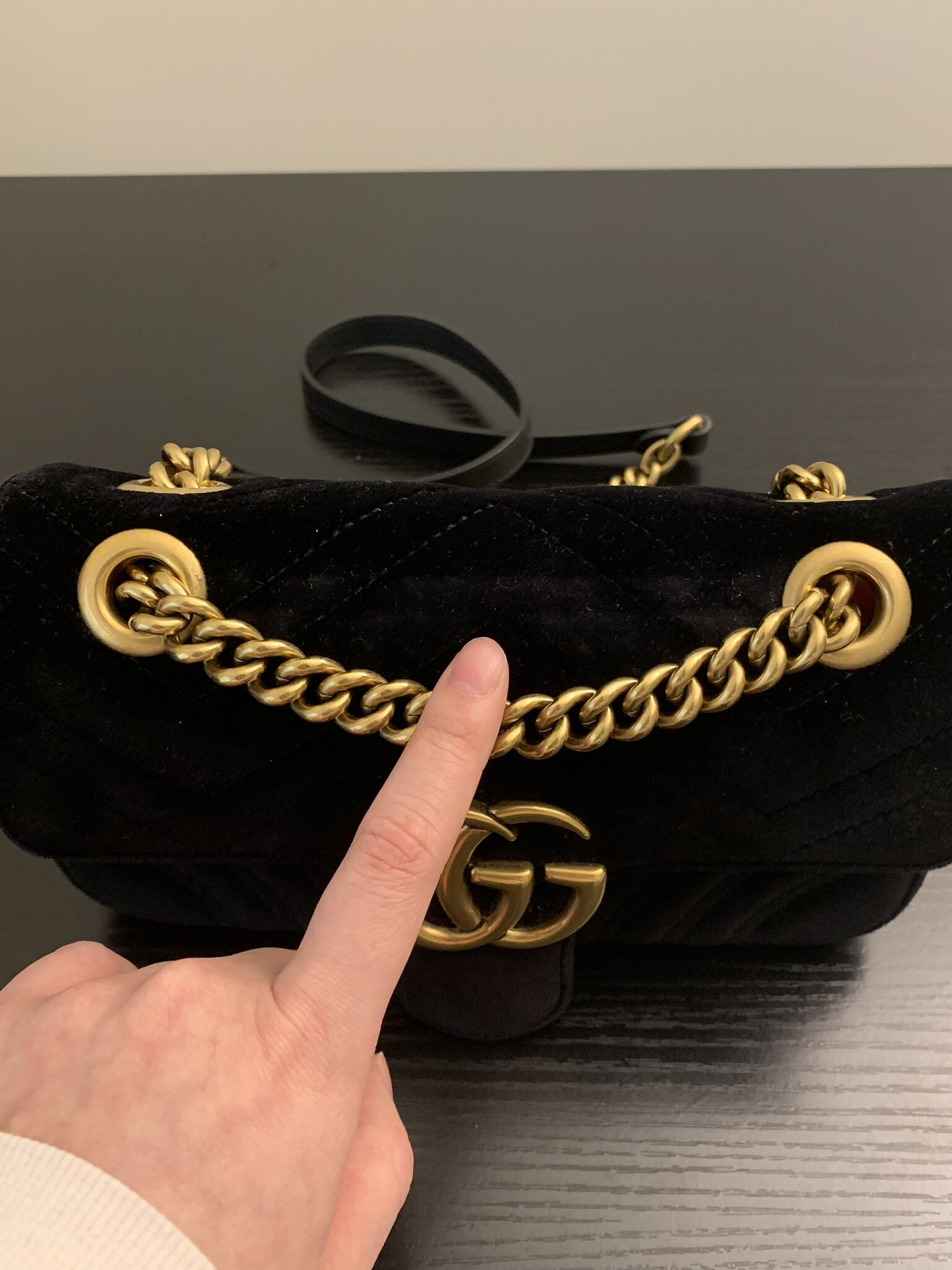 This part of the purse is where the most noticeable wear is. There is an indent on the velvet material due to the weight of the chain. This does not bother me because it is bound to happen with a velvet bag and when I wear my purse, it cannot be seen.