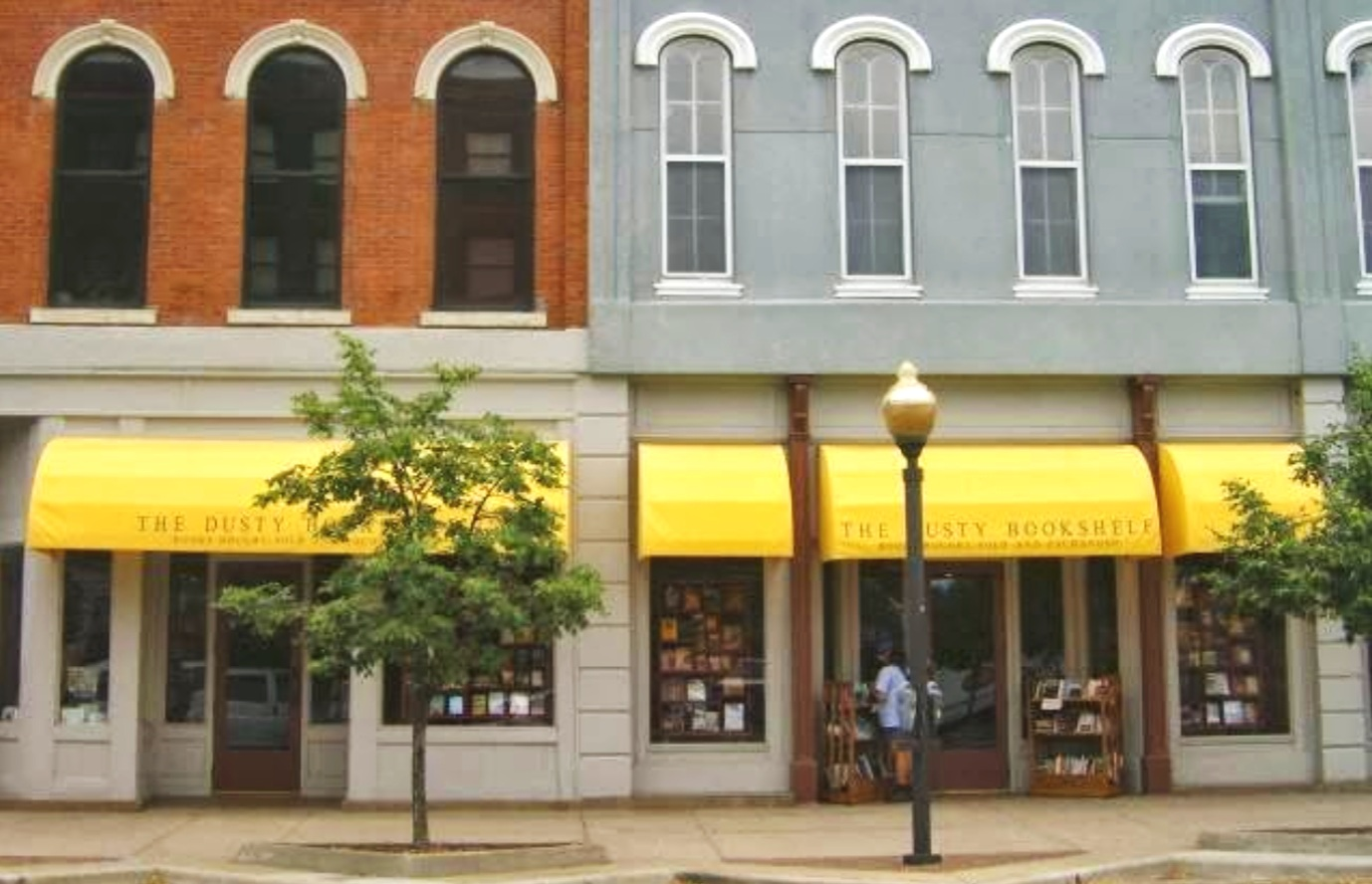 """LAWRENCE LOCATION - Find our Lawrence location at 708 Massachusetts Street. Stop by to shop our selection of used books, and don't forget to say """"hi"""" to Dinah the cat."""