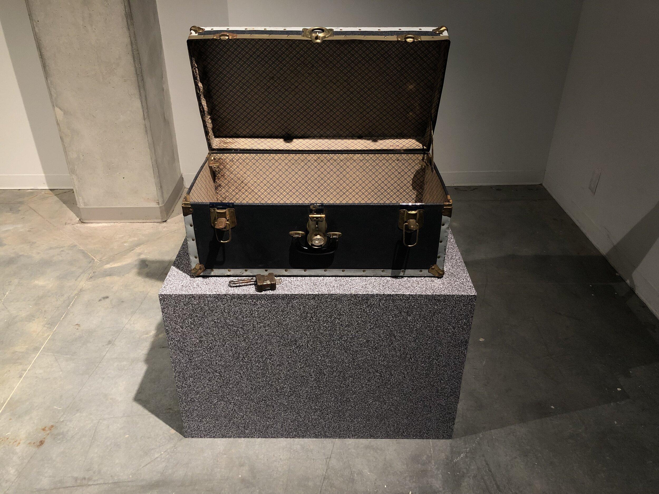Michael Edward Miller  Level One: Agency , 2019, reduction fired storage jar with granite feldspar, vintage padlock + key, patterned vinyl, MDF plinths, vintage chest, digital timer, players