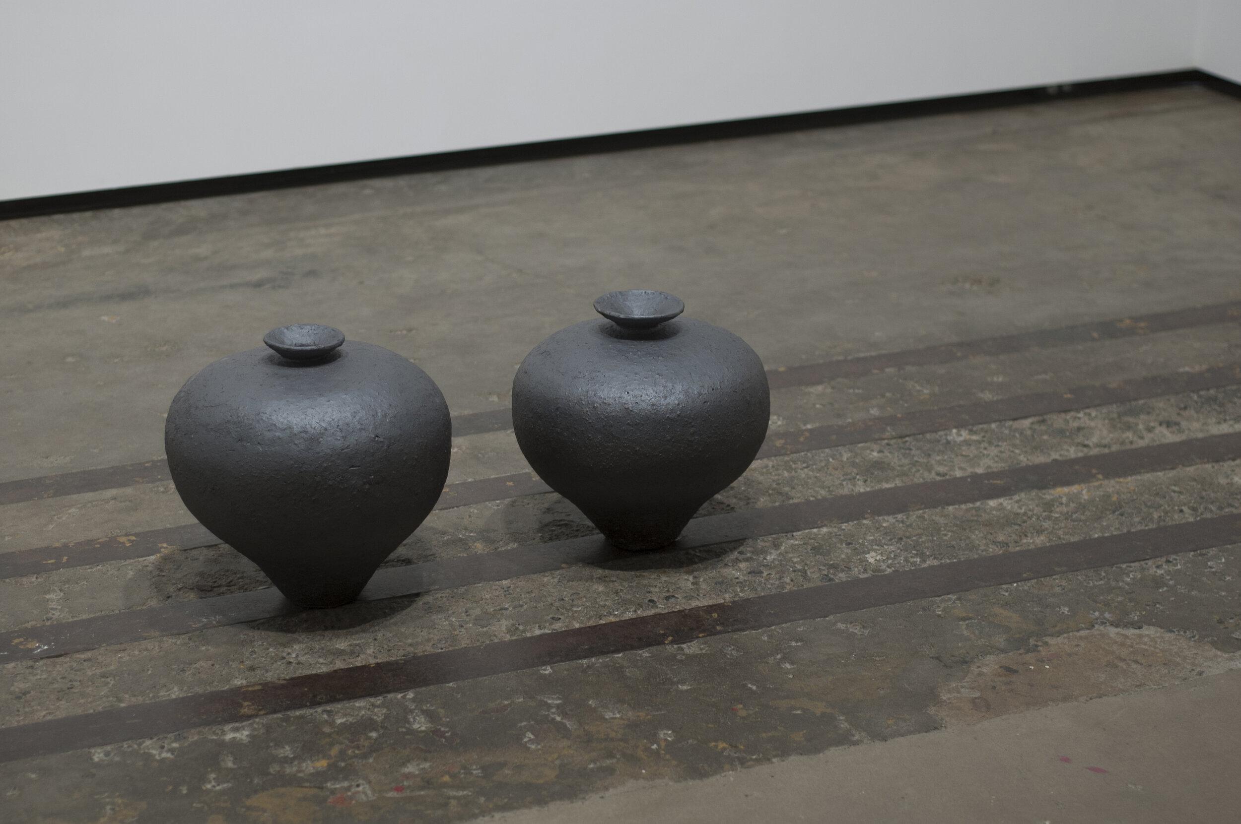 Michael Edward Miller  Fracture , 2016, hand-coiled reduction fired storage jars, granite feldspar, black smokey quartz crystal