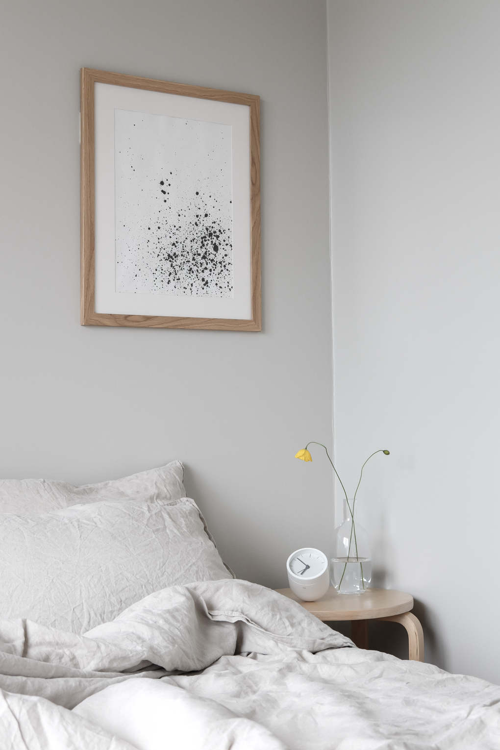 Modern-Scandinavian-style-bedroom-beige-linen-sheets-light-grey-walls-wall-art-and-yellow-poppies.-Styling-and-photo-by-Anu-Reinson.jpg
