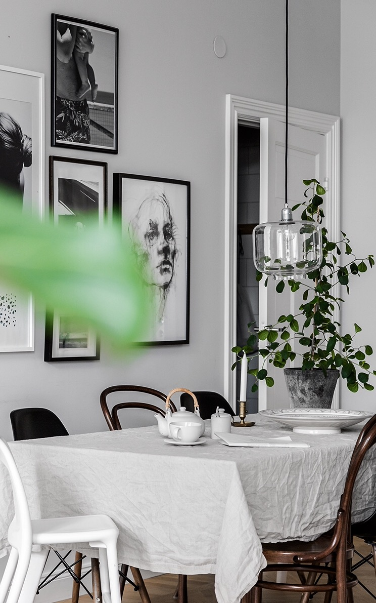 Scandinavian-dining-room-with-a-beautiful-art-wall-and-mix-of-chairs.jpg
