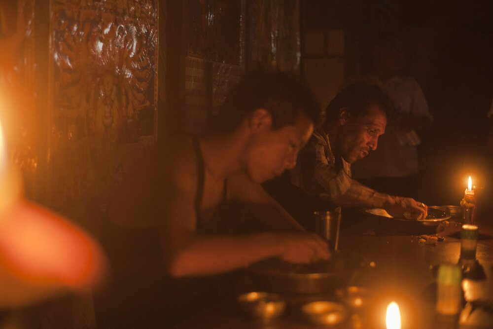 'Truck drivers enjoy a candle-lit dinner at Maa Kali Dhaba in Nagaland'.  Photo: Ozzie Hoppe