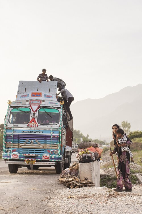 'A Gujjar family loads their belongings in the truck, which include cloth bags bound by coir and bundles of wood to keep them warm in the alpine pastures'.  Photo: Ozzie Hoppe