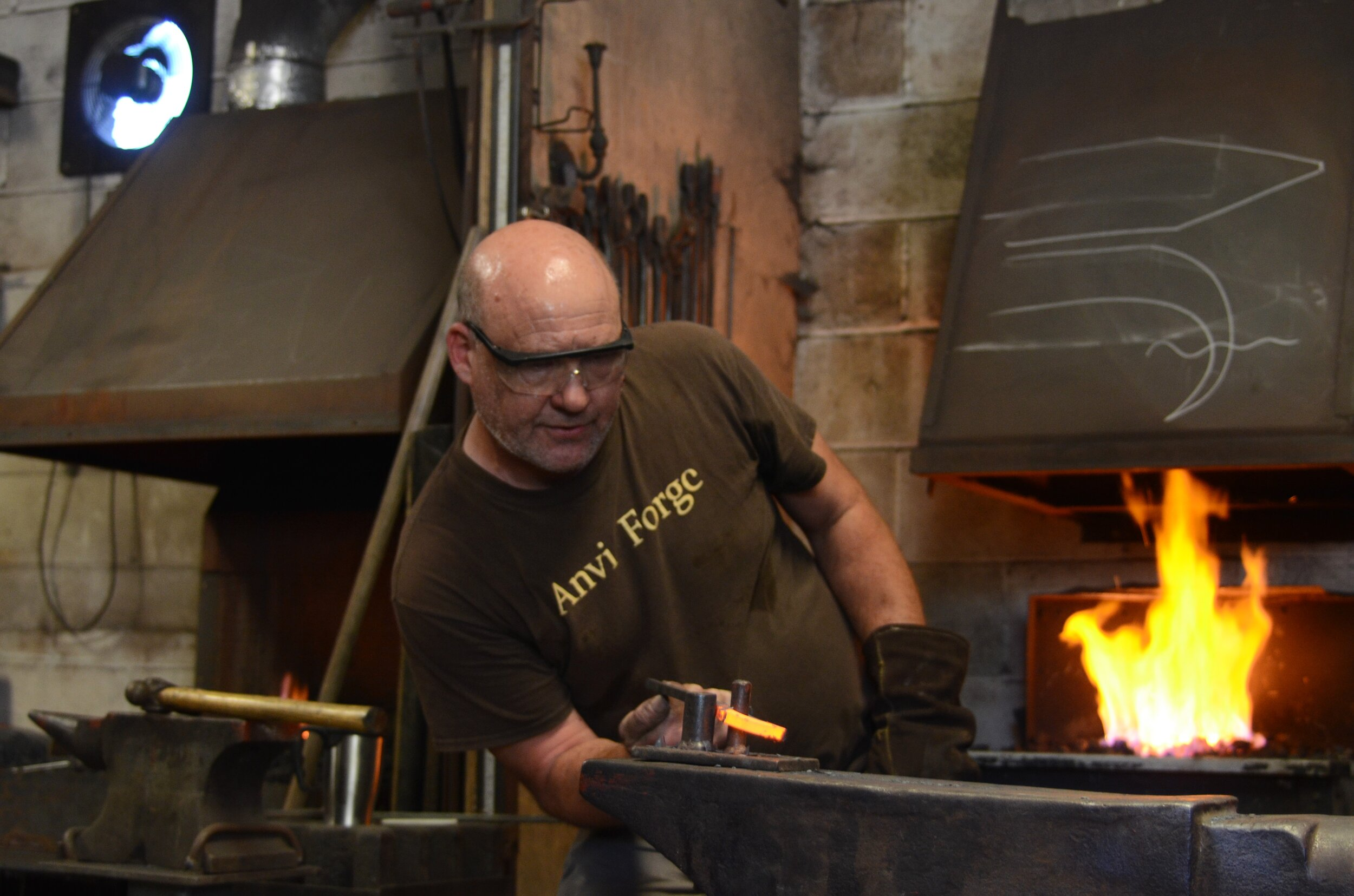 Spencer - blacksmith - Spencer joined John a number of years ago and has wealth of knowledge in not only blacksmithing and bladesmithing but site installations and problem solving for a variety of situations that arise when installing metalwork.