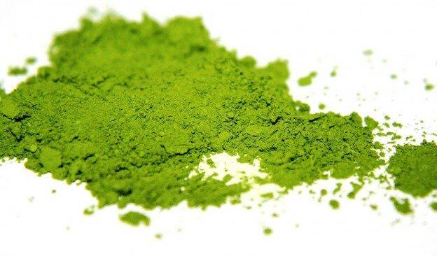 Matcha Green Tea powder, spread on white surface