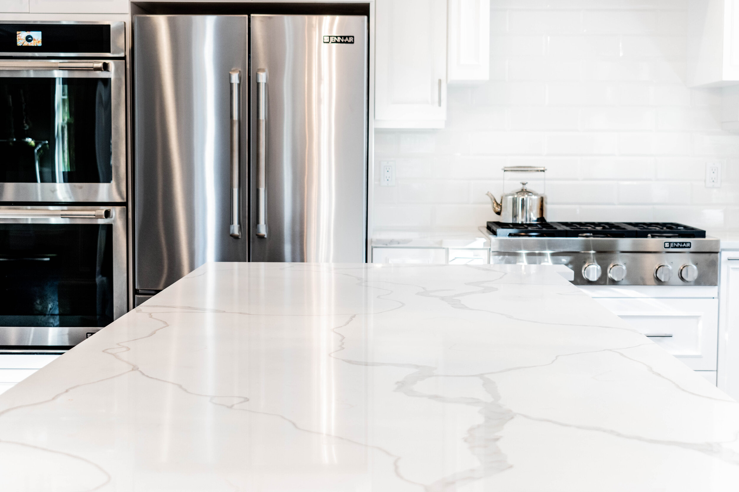 Material: Q-MSI Calacatta Classique (Bookmatched)  Thickness, Finish & Stone Type: 3CM Polished Quartz  Edge: Eased  Sink: ZAP ZP3417 HMZ
