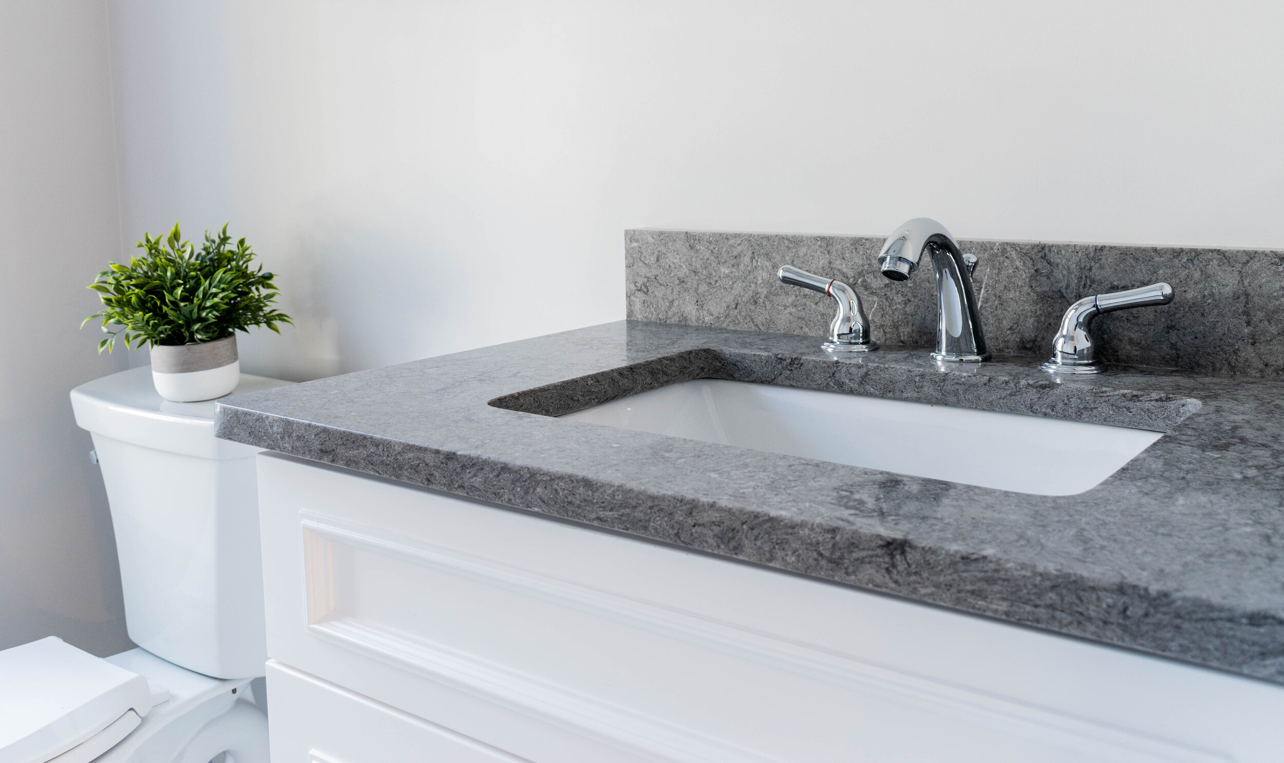 Material: Caesarstone - Turbine Grey (6313)  Thickness, Finish & Stone Type: 3CM Polished Quartz  Edge: Eased  Sink: KP-23W