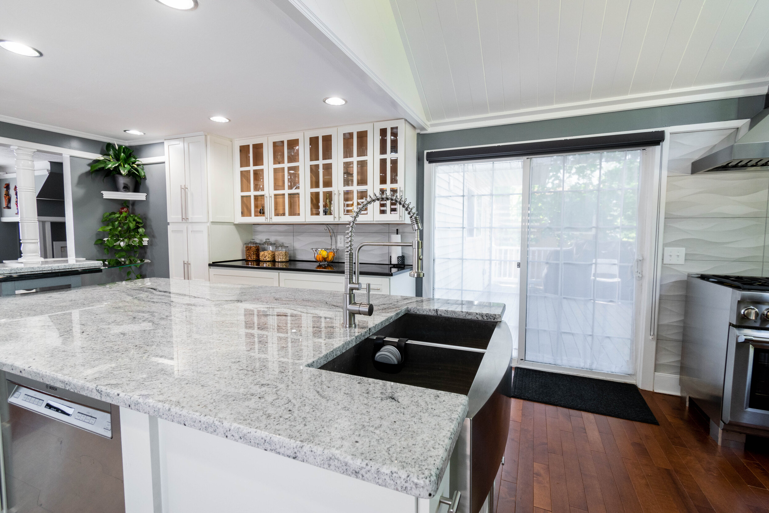 "Island Material: Viscount White Thickness, Finish & Stone Type: 3CM Polished Granite Edge: 1/4"" Bevel  Perimeter Material: Absolute Black Thickness, Finish & Stone Type: 3CM Polished Granite  Edge: 1/4"" Bevel  Sink: Client's sink - Farmer/Apron"