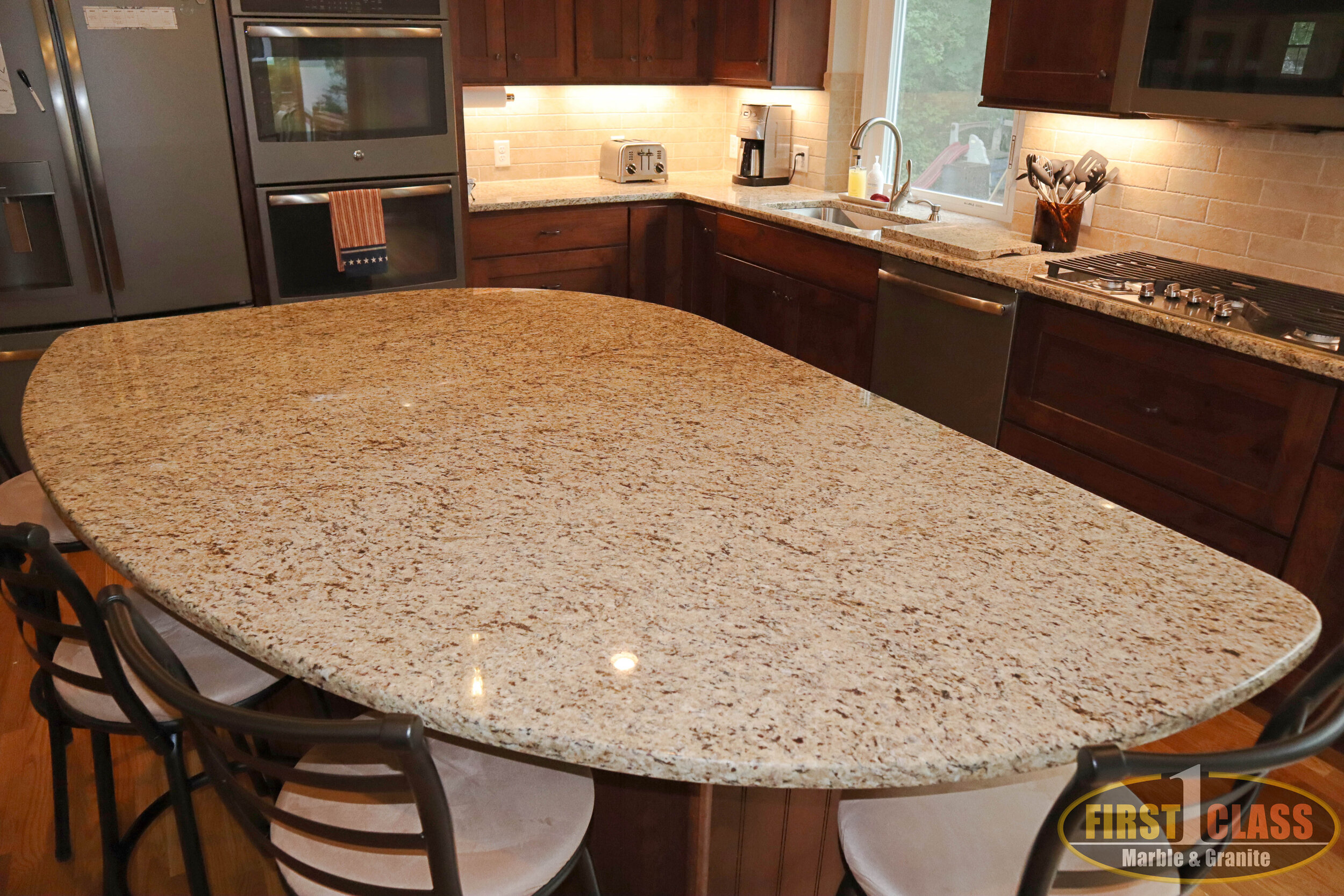 "Material: Giallo Ornamental Guidoni  Thickness, Finish & Stone Type: 3 CM Polished Granite  Edge: 1/4"" Radius  Sink: Client Sink: Under-Mount"