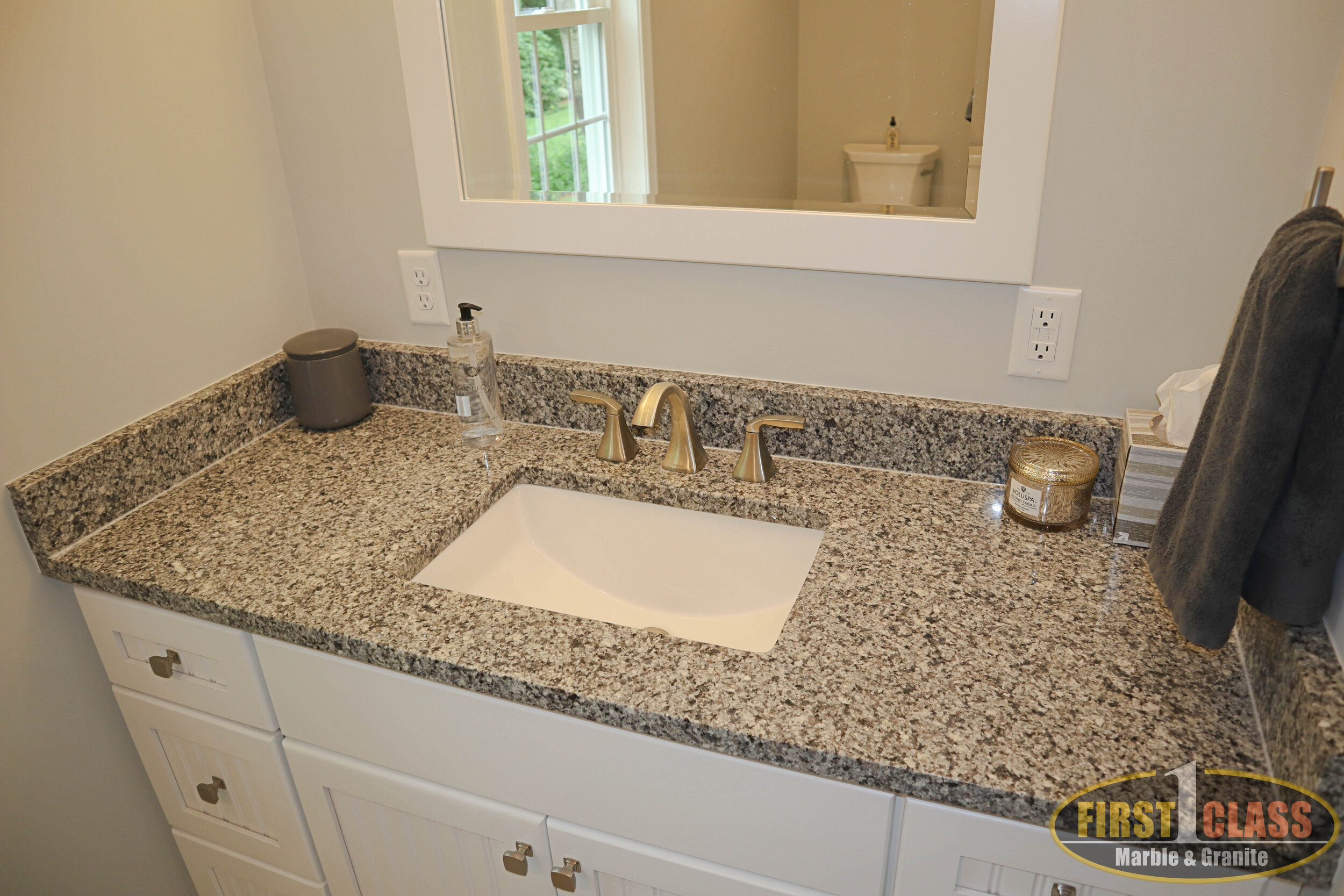 "Material: Azul Platino  Thickness, Finish & Stone Type: 3 CM Polished Granite  Edge: 1/4"" Radius  Sink: Client Sink: Under-Mount"