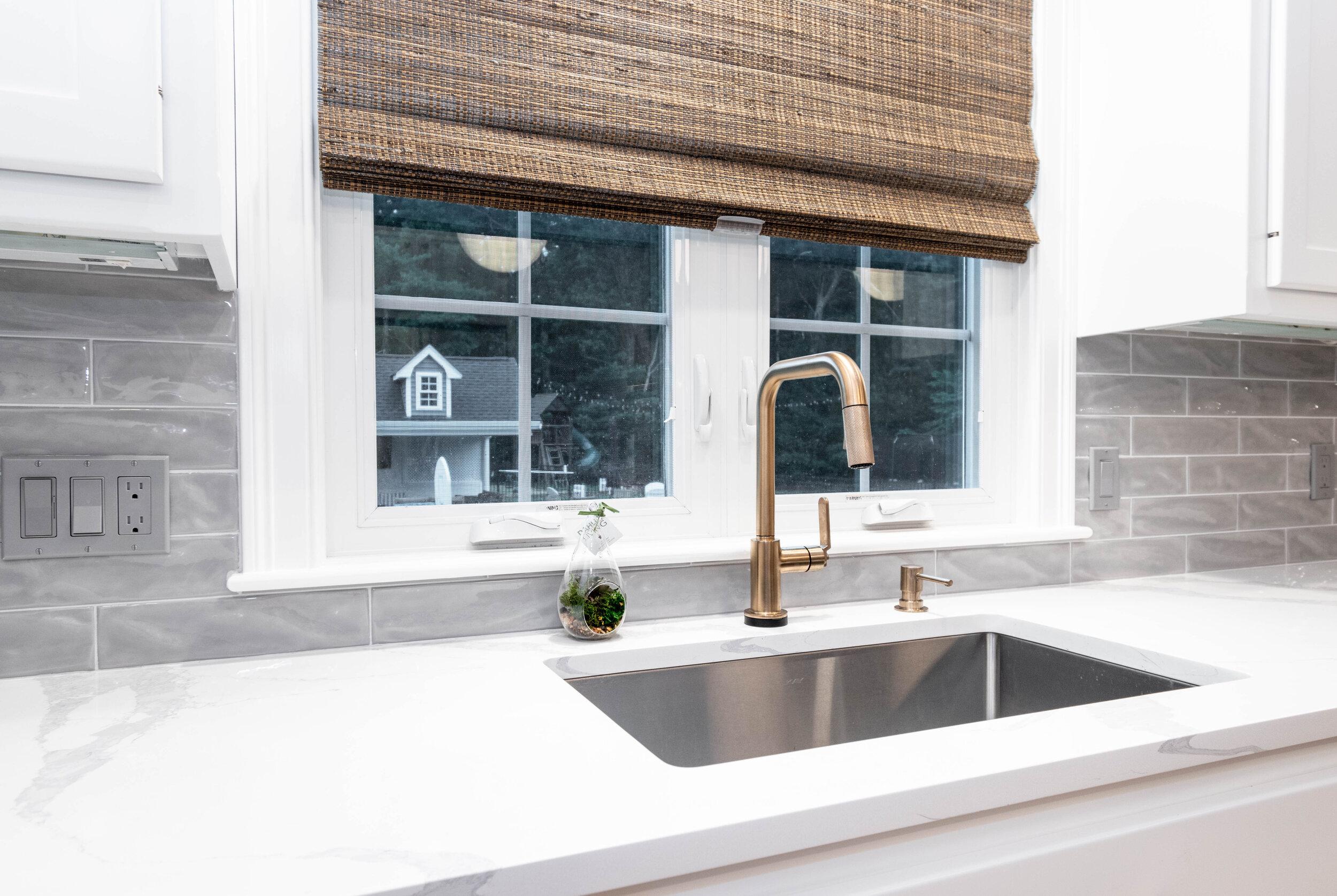 "Material: IndoQuartz Calacatta Venice  Thickness, Finish & Stone Type: 3CM Polished Quartz  Edge:  Perimeter Counters = Eased edge Island = 2 1/2"" miter  Sink: Client's sink: Under-Mount"
