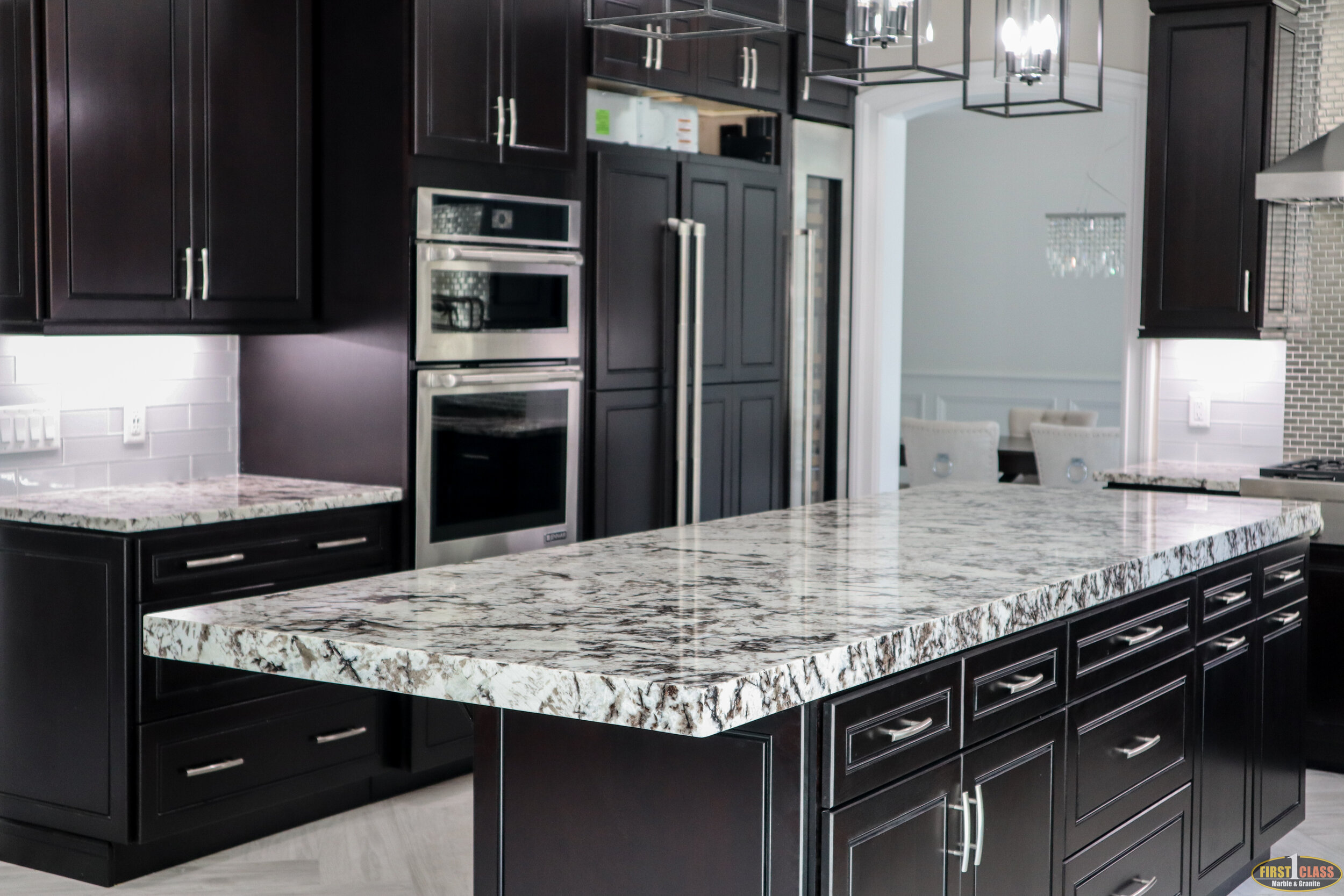 "Material: Cold Spring  Thickness, Finish & Stone Type: 3CM Polished Granite  Edge:  Main Counters: Eased Island: 2 1/2"" Mitered"