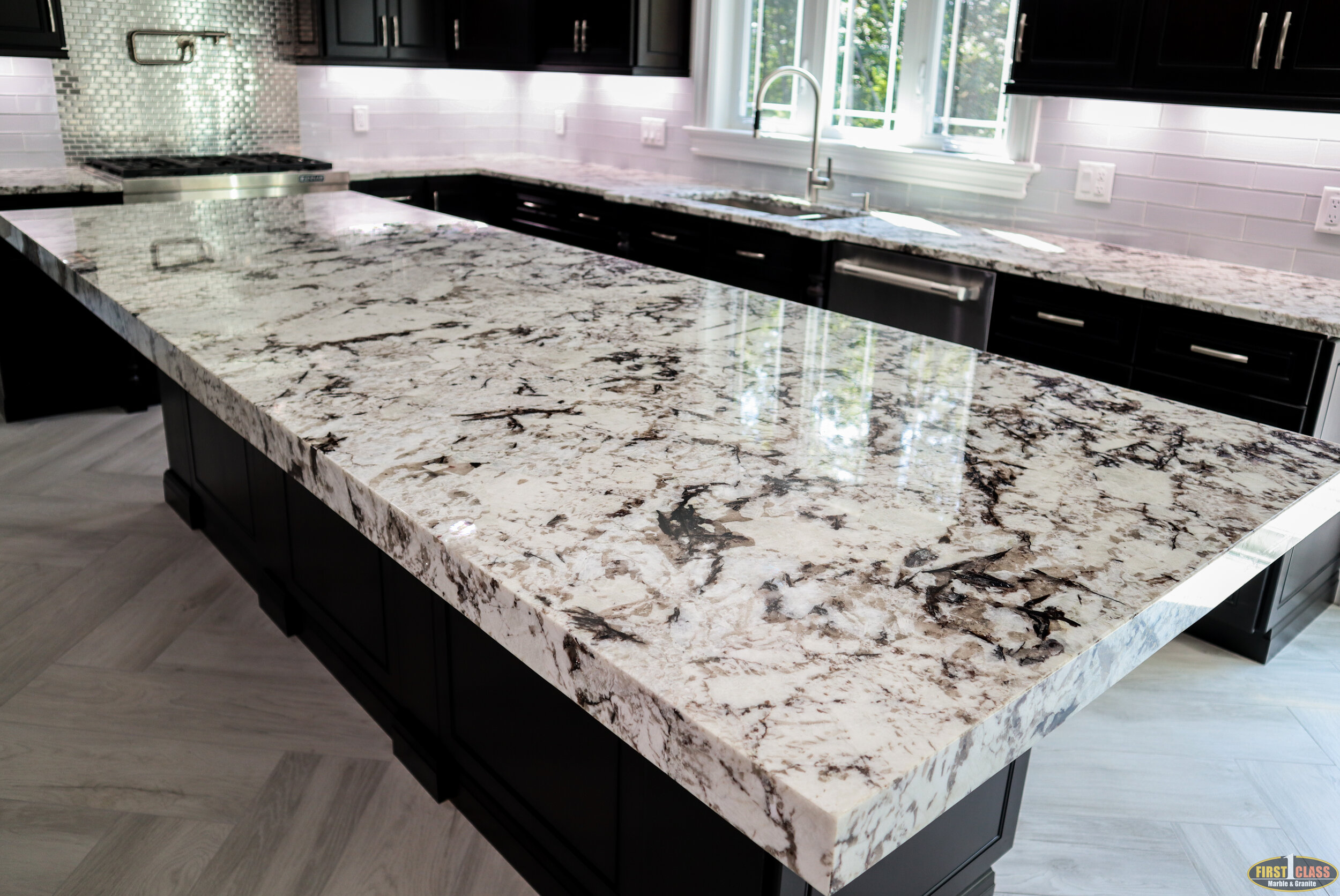"Material: Cold Spring  Thickness, Finish & Stone Type: 3CM Polished Granite  Edge:  Main Counters: Eased Island: 2 1/2"" Mitered  Sink: KH16-300"