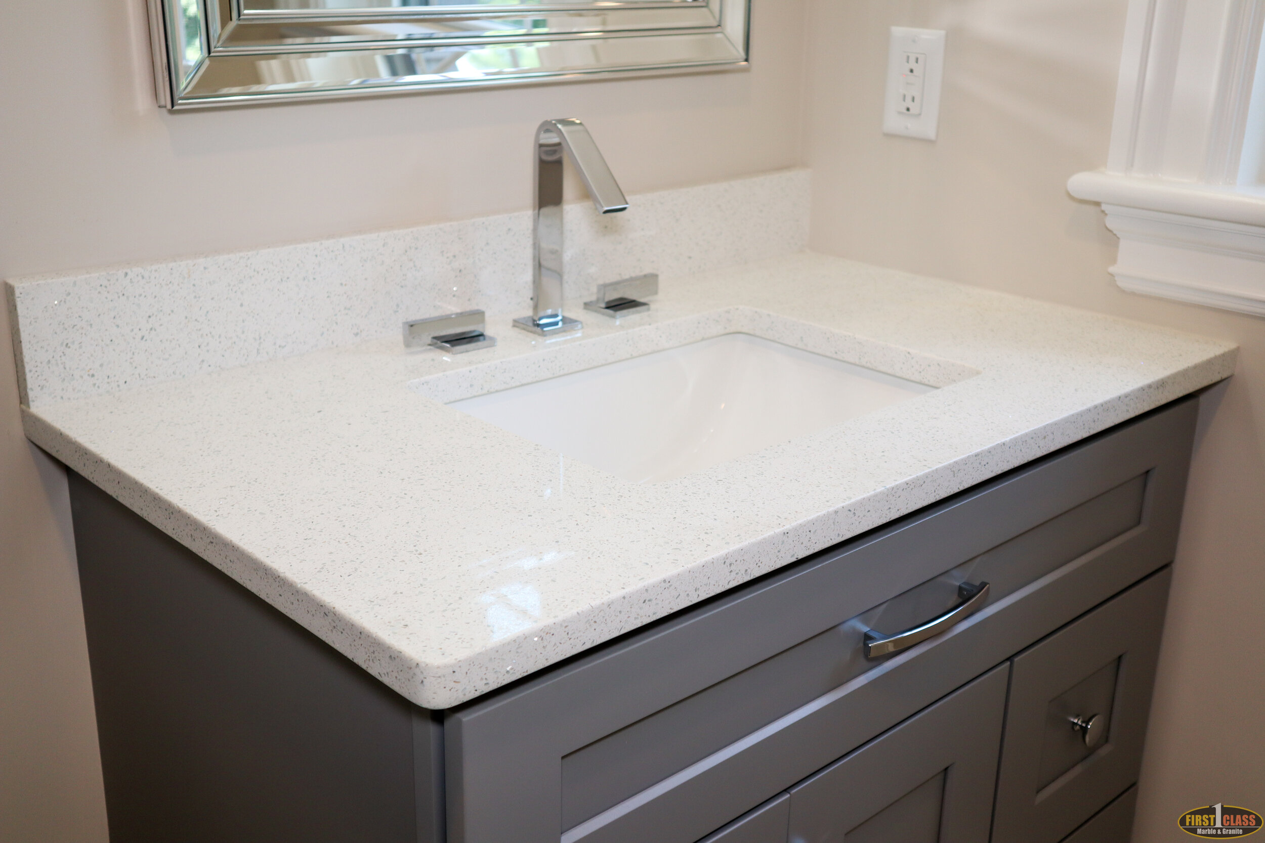 On-Suite Vanity  Material: Q-MSI Sparkling White  Thickness, Finish & Stone Type: 3CM Polished Quartz  Edge: Eased  Sink: KP-23 W