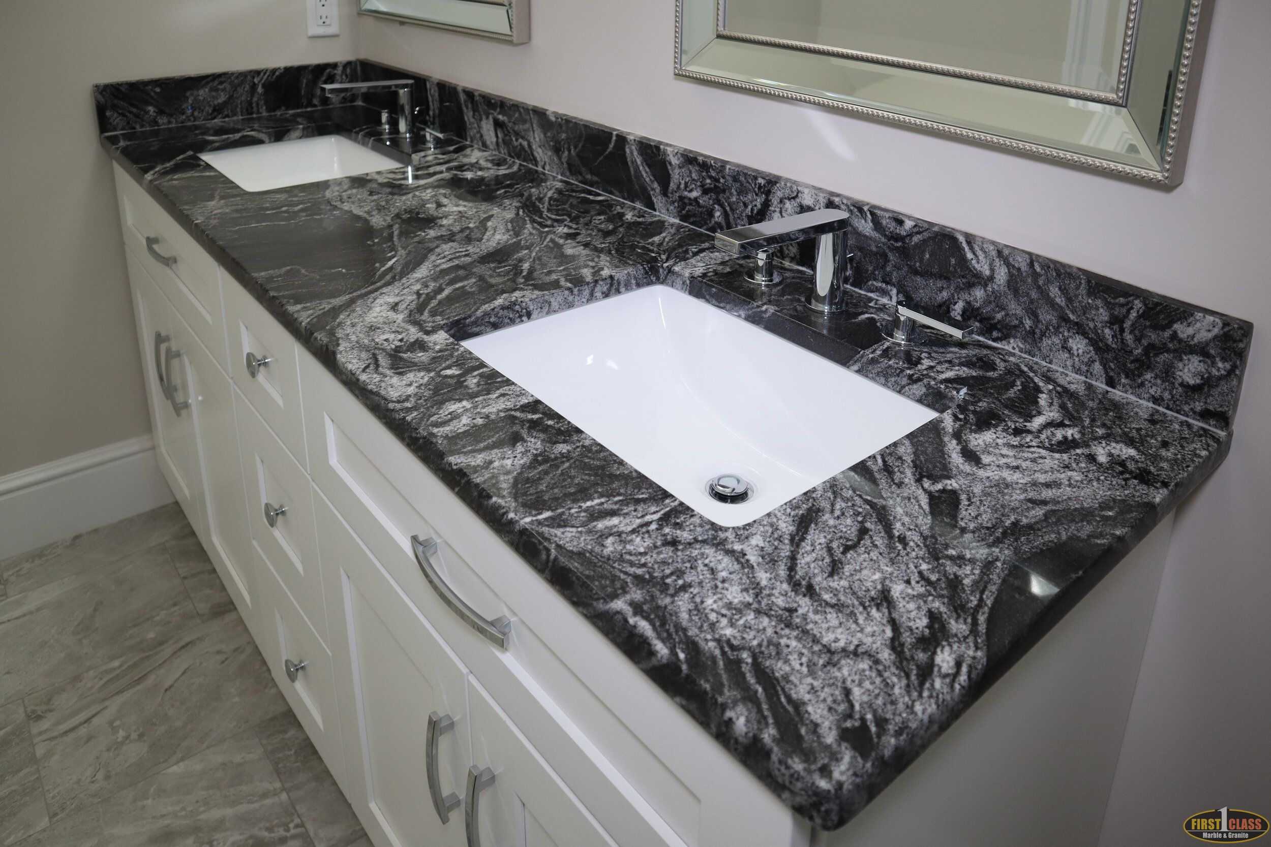2nd Floor Bath  Material: Silver Wave  Thickness, Finish & Stone Type: 3CM Polished Granite  Edge: Eased  Sink: KP-23 W