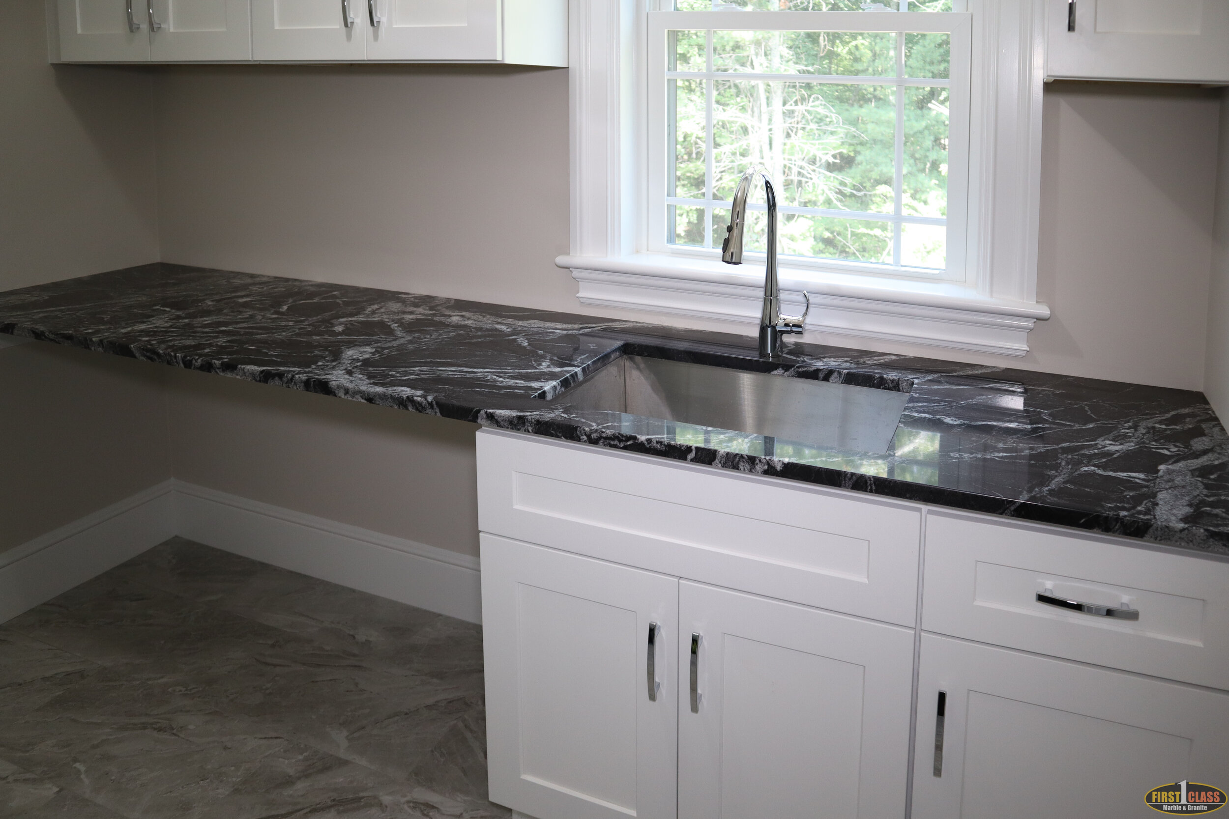 Material: Silver Wave  Thickness, Finish & Stone Type: 3CM Polished Granite  Edge: Eased  Sink: ZP2516 HMZ