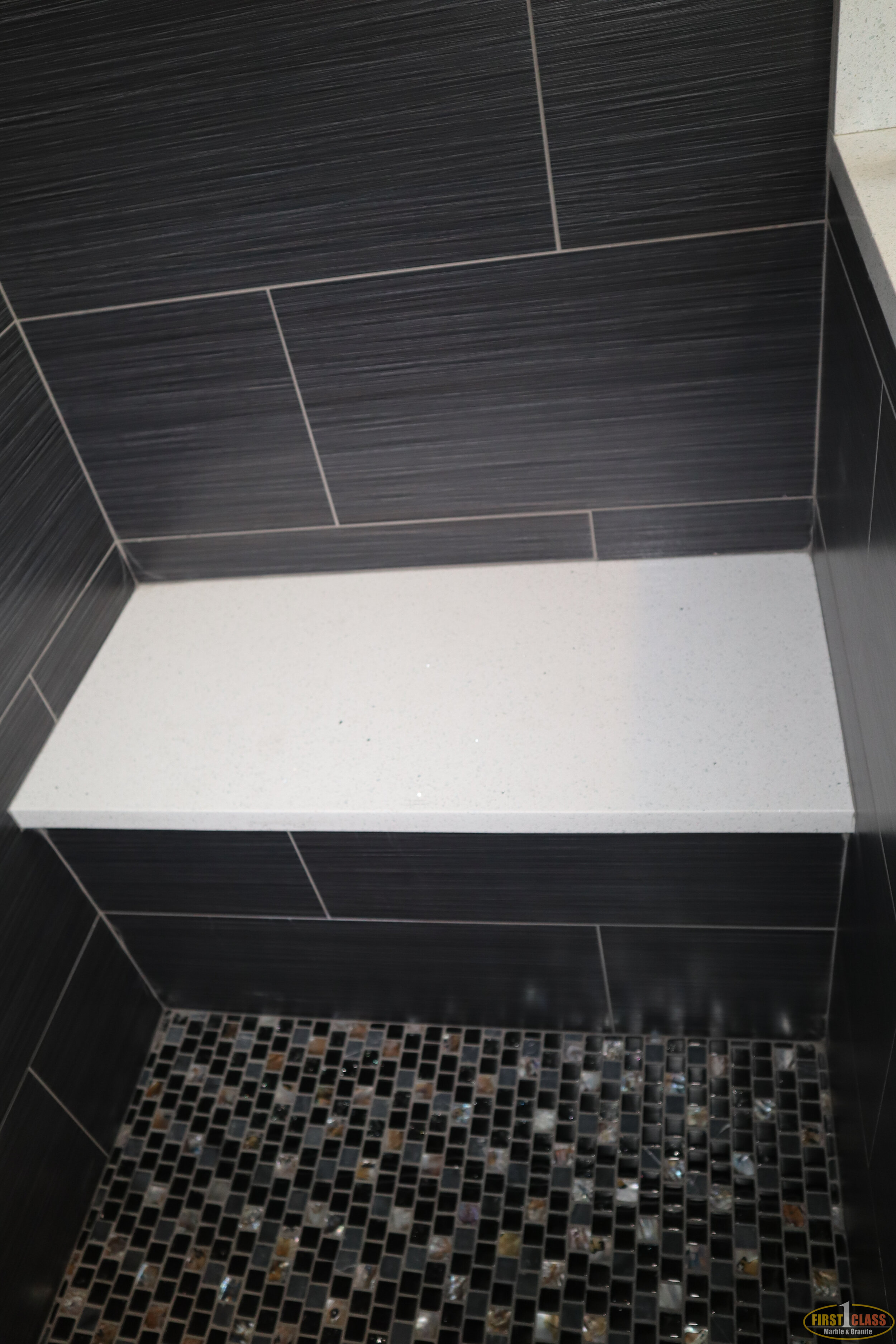 On-Suite Shower Seat  Material: Q-MSI Sparkling White  Thickness, Finish & Stone Type: 3CM Polished Quartz  Edge: Eased