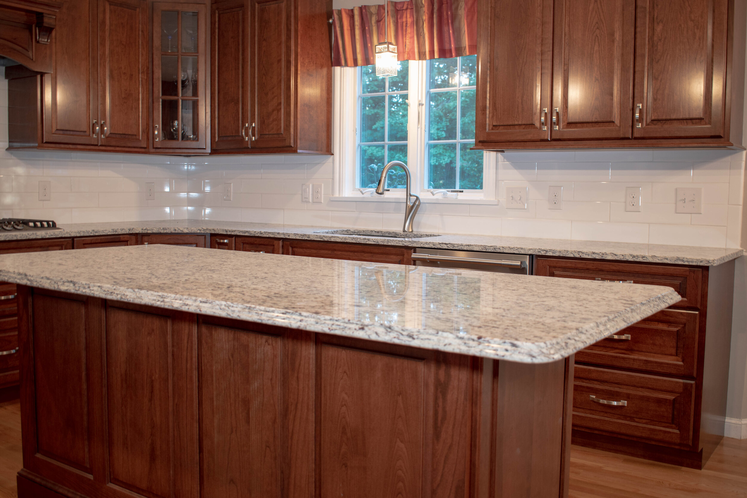 Material: SF / White Ornamental  Thickness, Finish & Stone Type: 3CM Polished Granite  Edge:  Main Counters: Eased Island: Waterfall  Sink: KB18-SP4