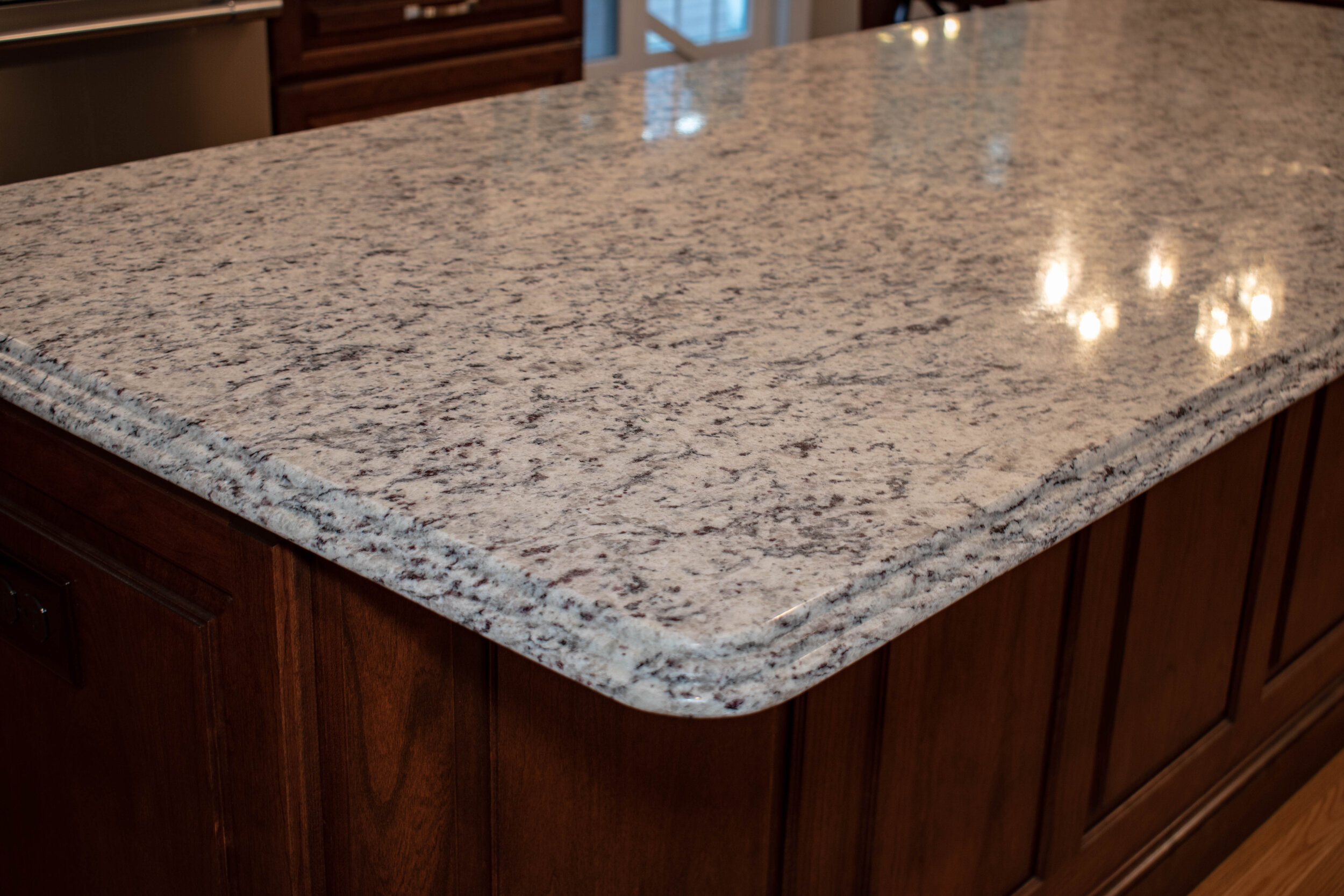 Material: SF / White Ornamental  Thickness, Finish & Stone Type: 3CM Polished Granite  Edge:  Main Counters: Eased Island: Waterfall
