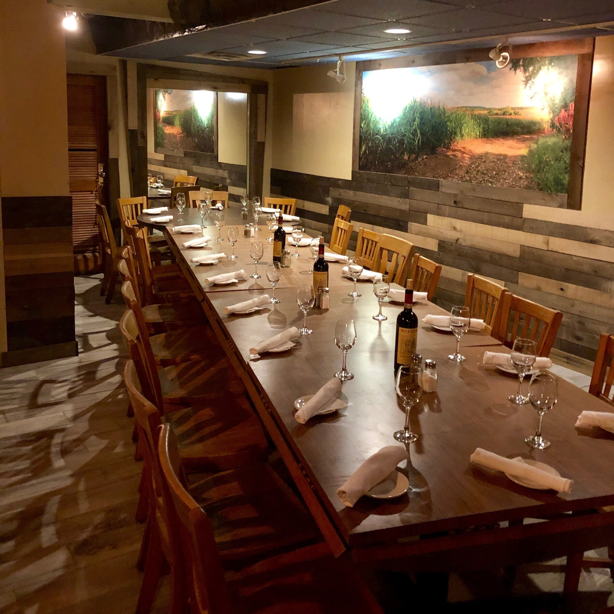 BANQUET SPACE - Our newly remodeled Banquet Hall is located under the main dining room. Featuring reclaimed wood finishes, a tranquil fish tank, and private restrooms. Seating accommodates up to 60 people.