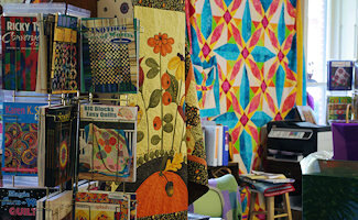 Quilts at the Marshall House is a large store dedicated to helping customers choose the best combination of fabrics for their project. They have more than 4000 bolts of quilting fabric, specializing in Asian, Batik, and 19th century reproduction fabrics.