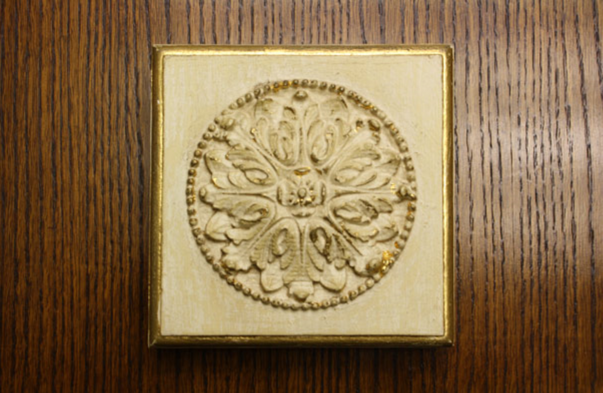 GILDING   - Process of applying either metal leaf or true gold leaf to surfaces.