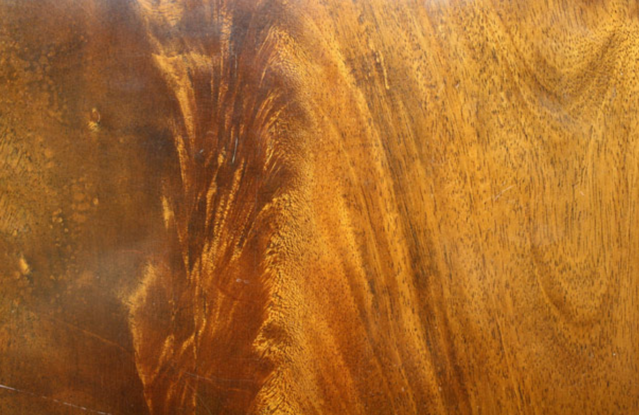 STAINING   - Process of achieving a color on wood that allows the grain of the wood to show through.