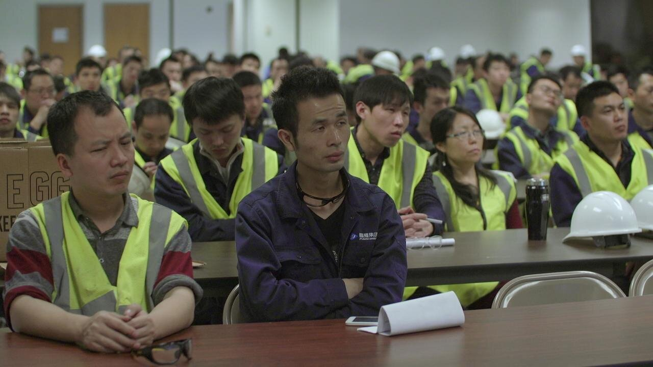 Employees are shown at work in China and the United States