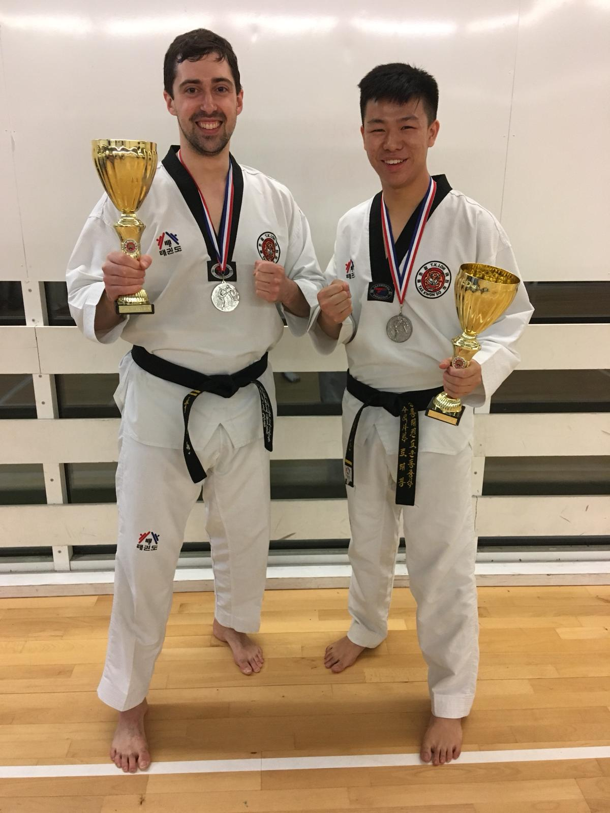 Mr Cornwell and Matthew with their trophies