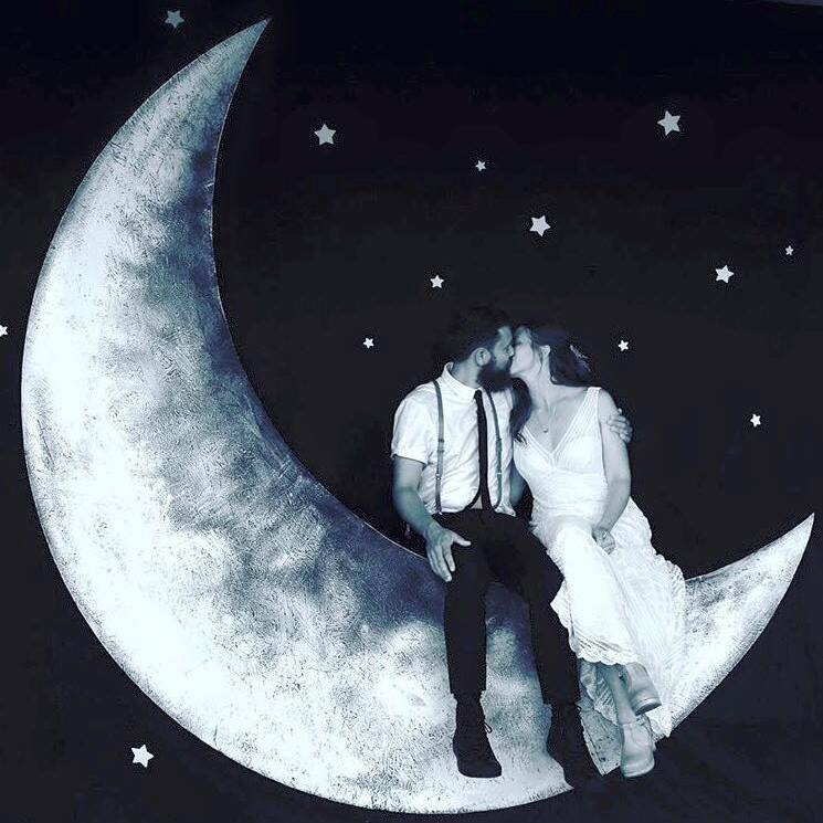 Paper Moon for wedding photos . Built on site outside of the civil war museum on Peaks Island in Maine. -wood, paint , black fabric, magic.