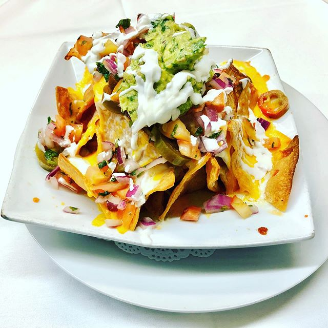Nachos Salad: Corn Tortilla Chips, Melted Mozzarella and Cheddar Cheeses, Guacamole Pico De Gallo, Sour Cream, Sliced Jalapeno