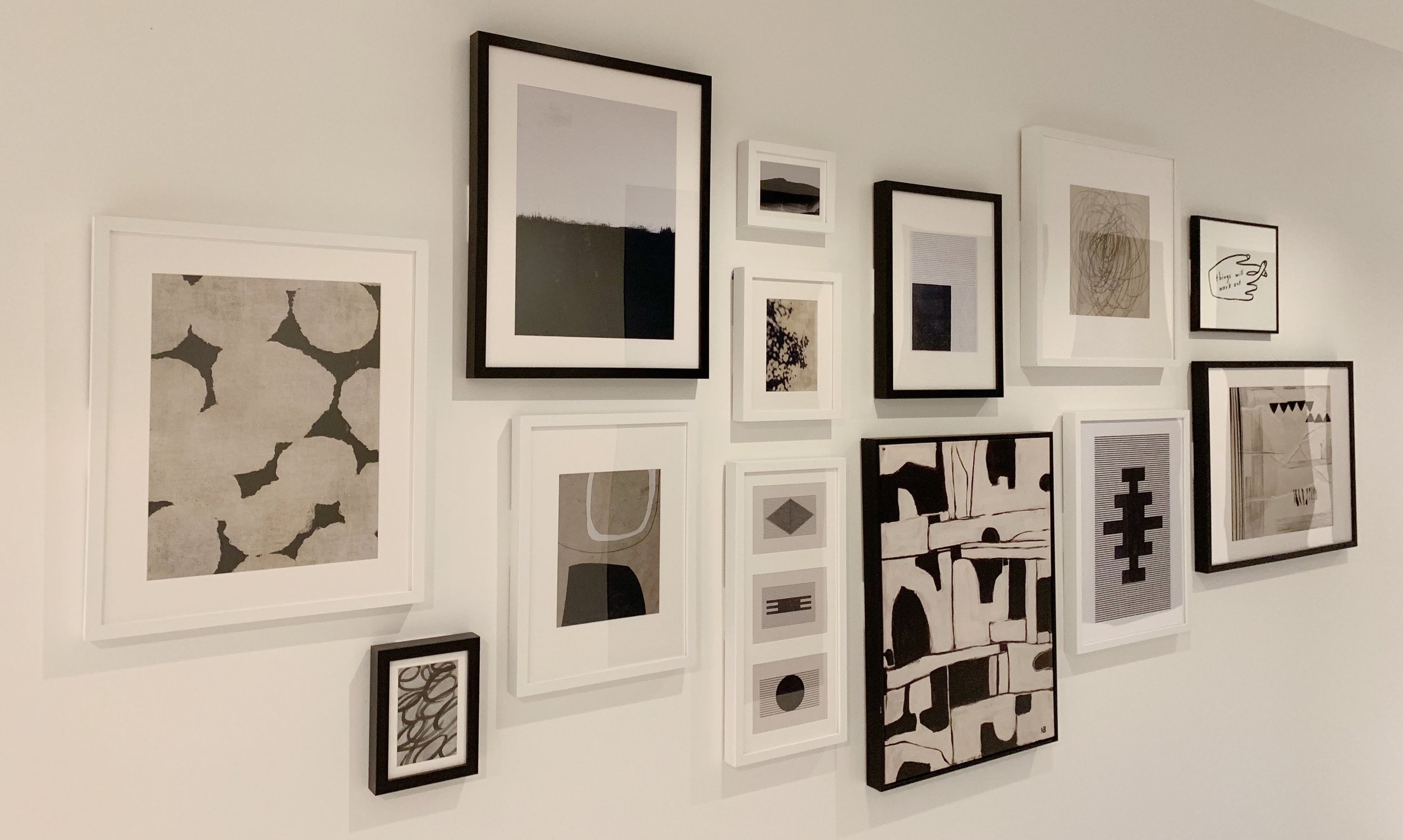 A crappy iPhone photo to show you this gallery wall as a whole!