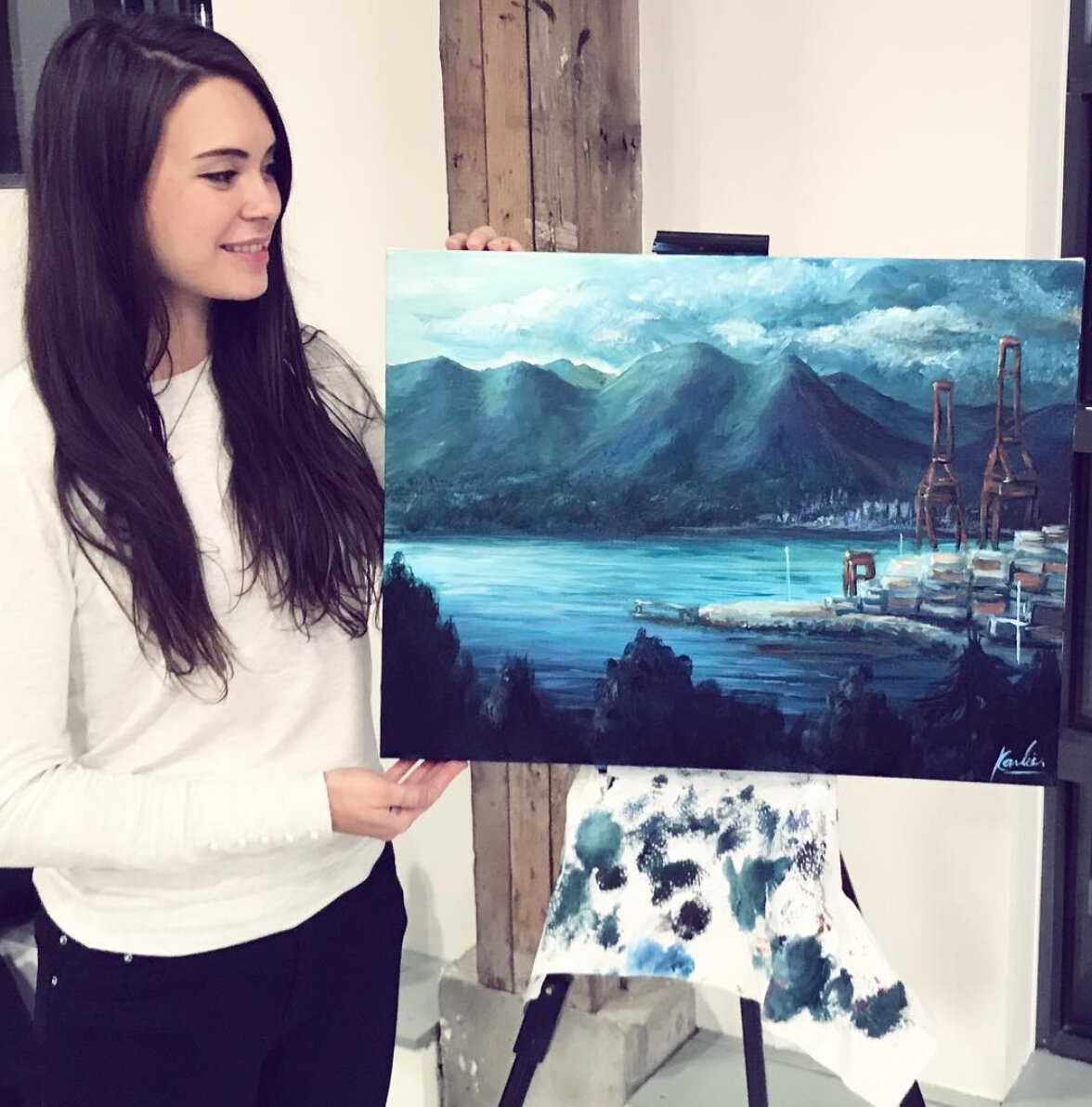 Karlie Carpentier Rosin paints many landscapes, among other subjects, and here she is after painting live at an event for 2h with acrylics on canvas. Gastown views of North Vancouver