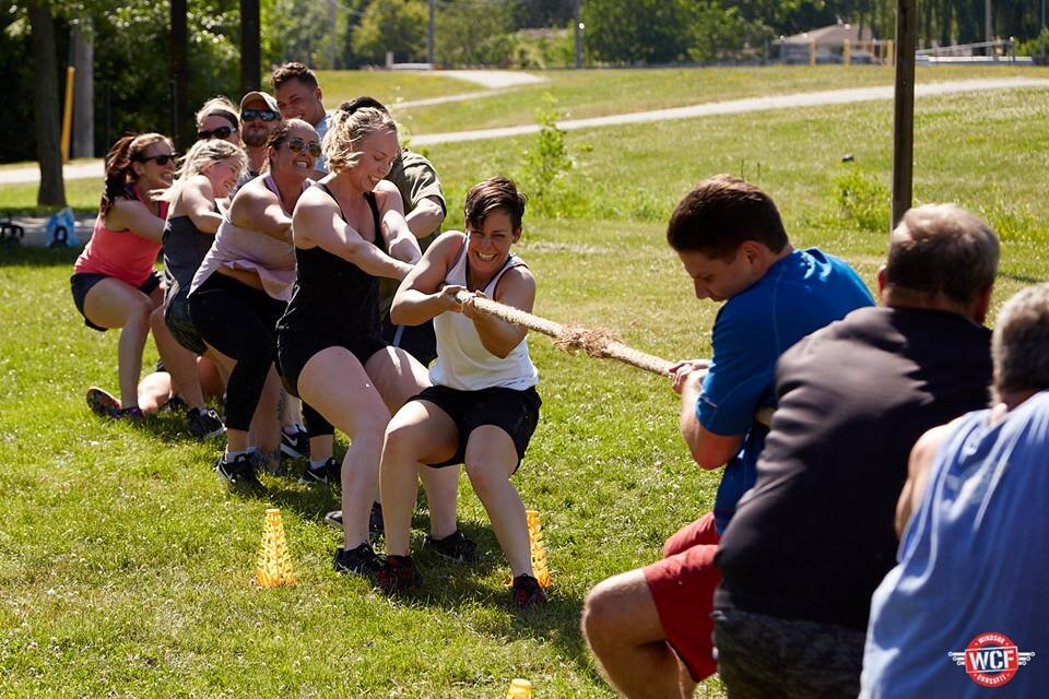 """Off-Site WODs - every summer we shake things up with our """"get out of the box"""" campaign. hill work, swimming, rock climbing, kayaking, track days - you name it, we've probably done it."""