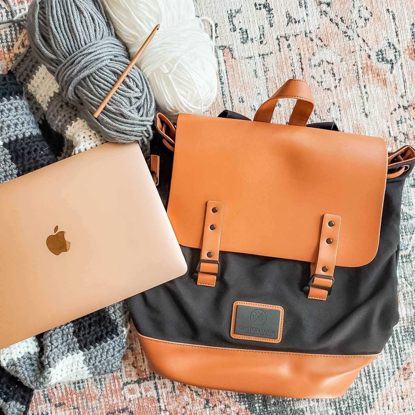 I am so excited for my new @gastonluga bag! ? I've been looking for a perfect, cute bag to fit my new MacBook, and this fits the bill perfectly! - See my stories for some of my favorite features of the bag. Use code CND_15 to get 15% off your purchase. And right now they're running a deal that you get a free Börs wallet with a purchase of a backpack. - Do you see that Buffalo Plaid Crochet WIP I'm working on? I've been slowly working on it when I can with a newborn. It is going to be a Christmas Tree Skirt, but not your typical one. I'm excited to eventually finish it, so I can show you my fun twist on a traditional skirt. ? - So do you think I'm crazy for working on a crochet Christmas pattern in September? I may be, but I love designing Christmas Tree Skirts. And life with a newborn is slow-moving, so I'll be lucky if I can finish this in time for the season. ?♀️ - #anywherewithGL #GastonLuga #farmemian #crochetboho #bohocrochet #macramevibes #macrame #beginnercrochetpattern #homedecor #crochethomedecor #beginnercrochet #bohoinspiration #bohostyle #minimalismcrochet #crochethome #crochetbohotheme #cozynooksdesigns #macramedecor #crochetdecor #crochetdecorpattern #easycrochet #bohome #bohodecor #craftsposure #etsysuccess #crochetdecor