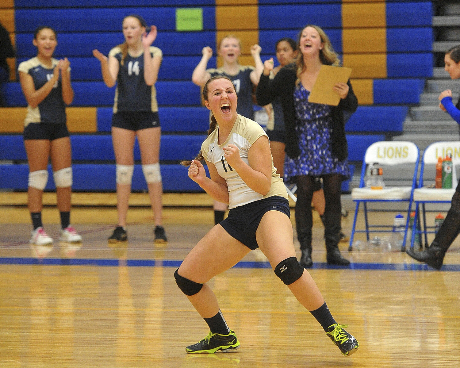 Sweethome's Victoria Rigler celebrates a point as Williamsville East faces rival Sweethome in Section VI Class A Girls Volleyball Championships at Lockport High School.