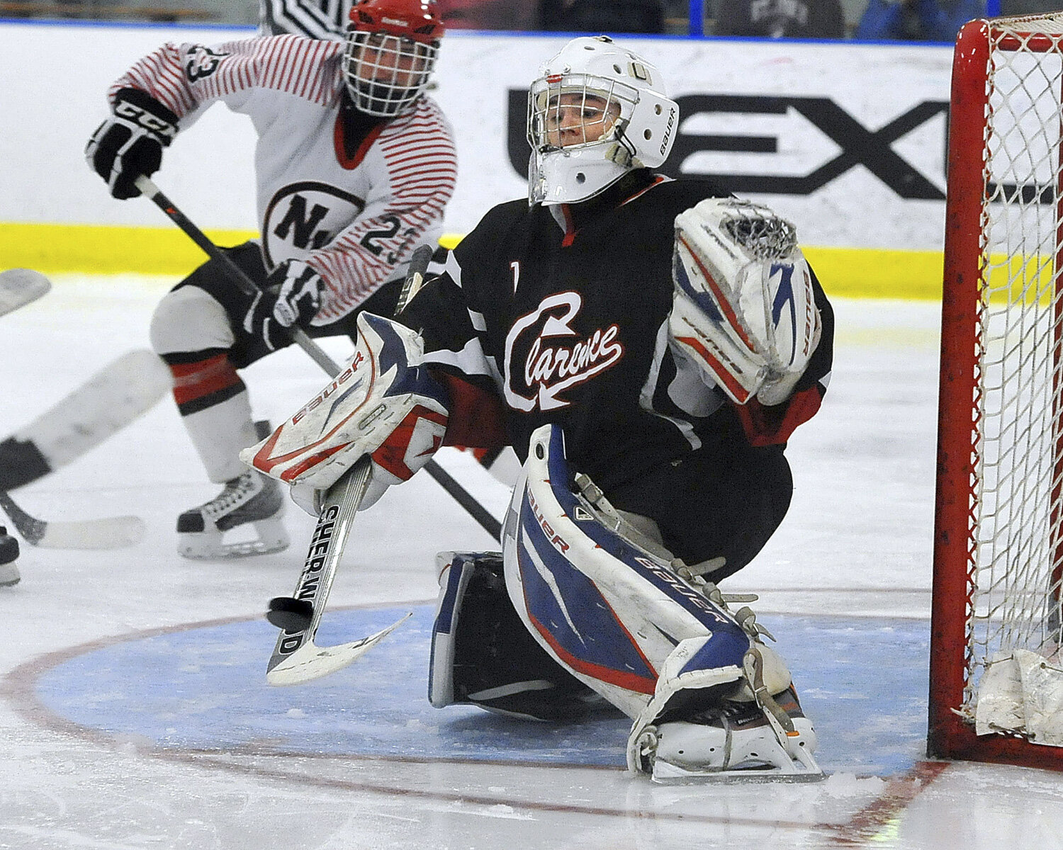 Red Devils goalie Jack Niesyty makes a stop on his stick as Clarence takes on Niagara-Wheatfield in Section VI Large Schools semifinal at Northtown Center at Amherst.