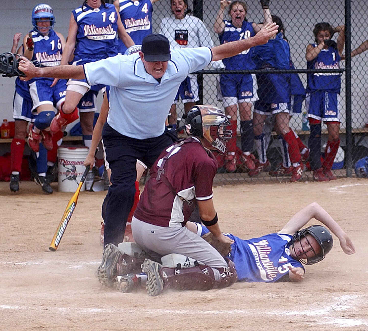 South's #15 Anna Braunscheidel scores the only and winning run against Newark on a base hit by #24 Ashley Coomber as Williamsville South girls softball defeats Newark in the Far West Regionals at Nan Harvey Field on University at Buffalo Campus.